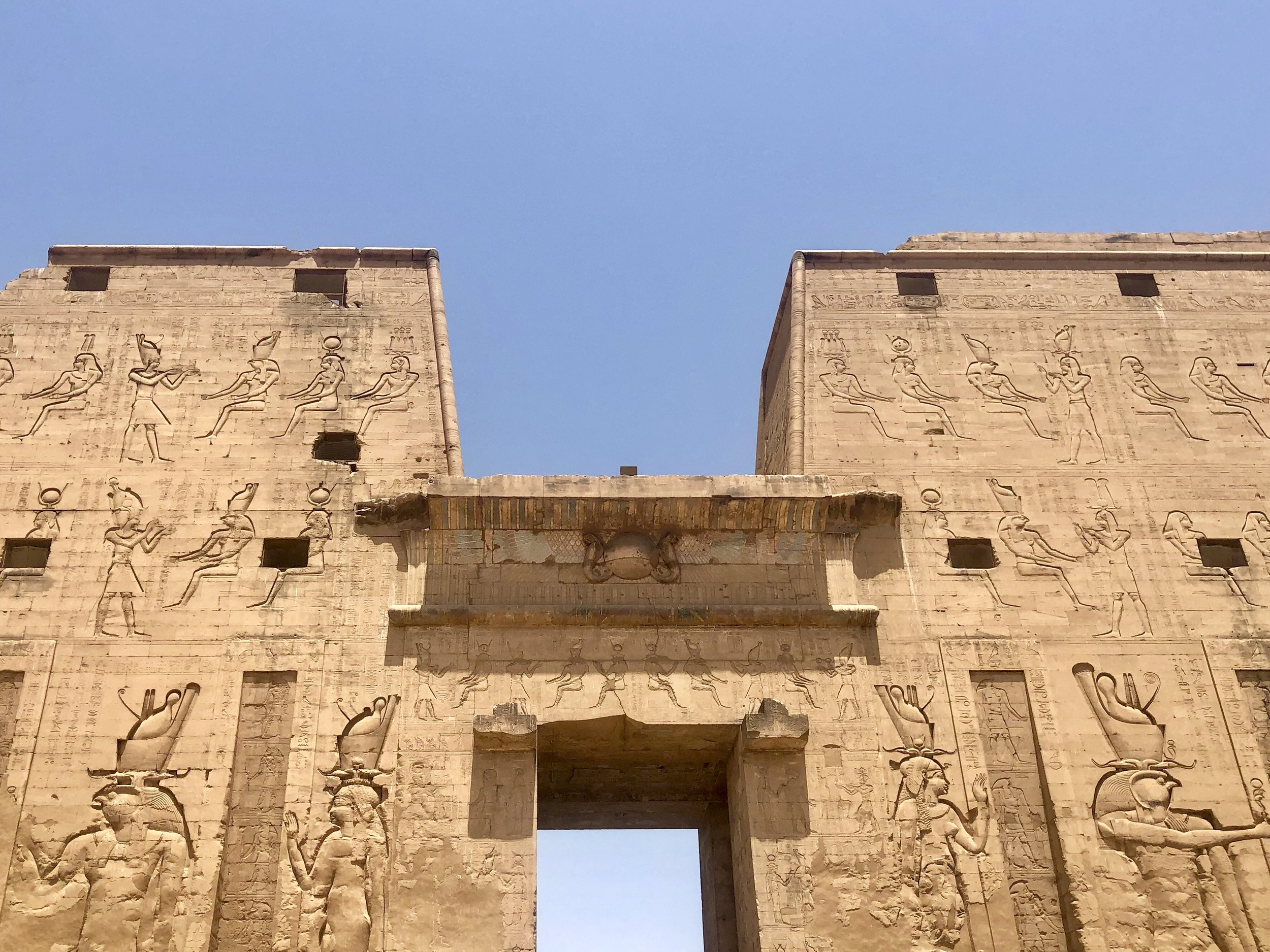 The Ptolemy rulers adopted Egyptian customs, including depicting themselves with the gods on the walls of temples