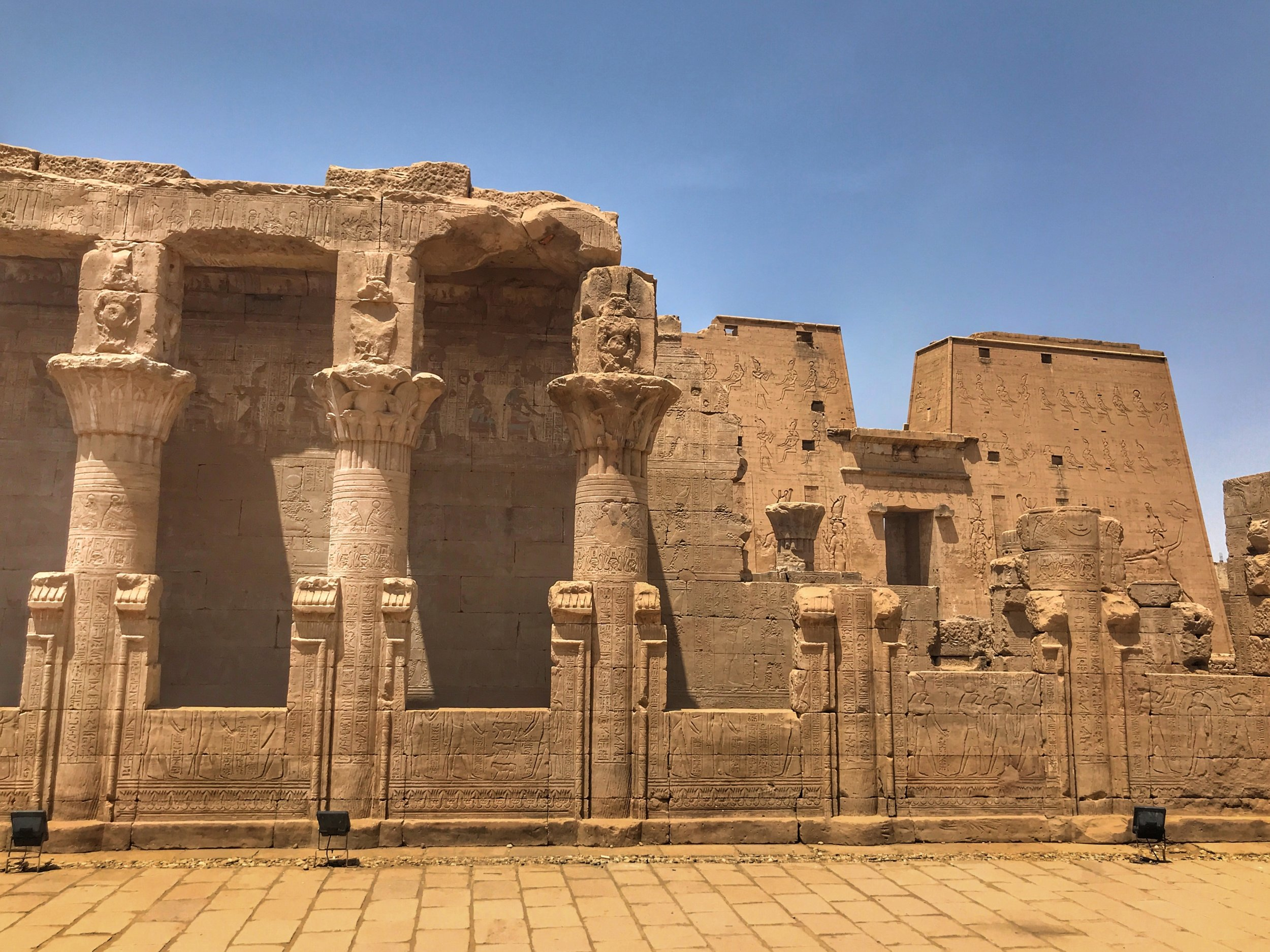 The mammisi in front of the main temple at Edfu honors Harsomptus, the son of Horus and Hathor. The courtyard in front of smaller structure was the site of an annual festival of singing and dancing