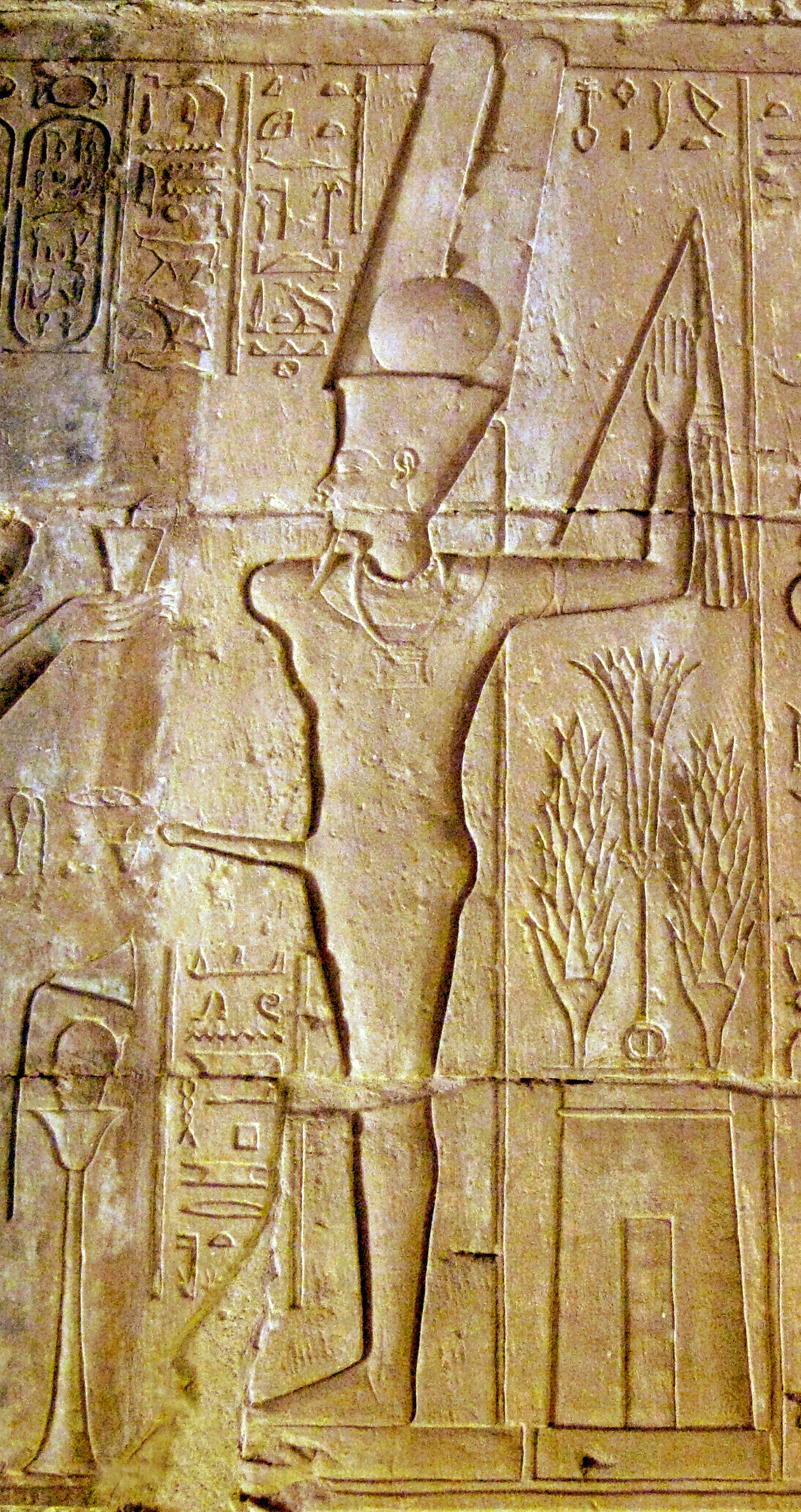 "The chief god at the time, Amun, here seen merged with the one-armed, one-legged deity Min, needed to be given ""a helping hand"" every morning, and this was one of Hatshepsut's duties"