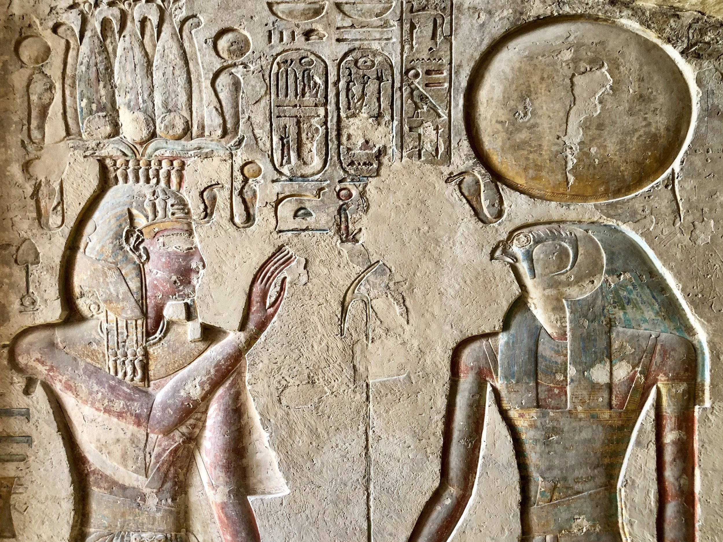 The pharaoh is welcomed to the afterlife by the falcon-headed god Horus