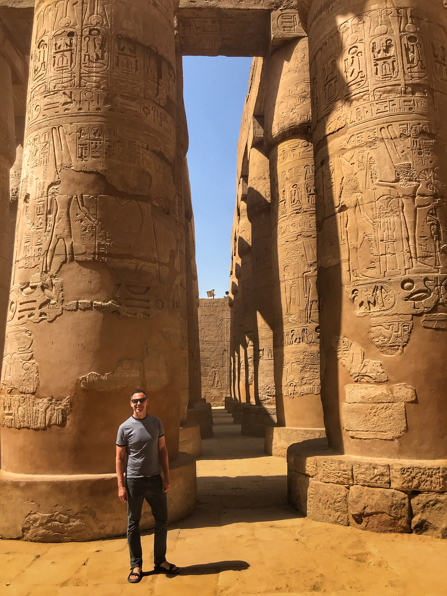 Duke stands in the ruins of Karnak Temple, a massive complex that Hatshepsut helped build (and, as such, once sported countless depictions of the female king)