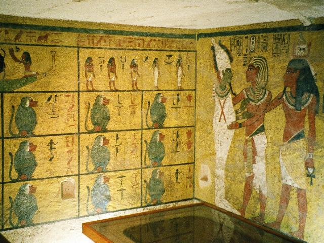 On the wall to the right, Tut is shown with his ka, or embodied soul, worshipping Osiris, the mummified god of the afterlife