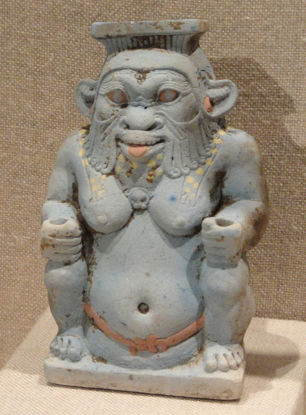 A cosmetic jar shaped like Bes. Both sexes wore makeup, in part to protect from the sun and insects, so the connection to a protector god makes sense