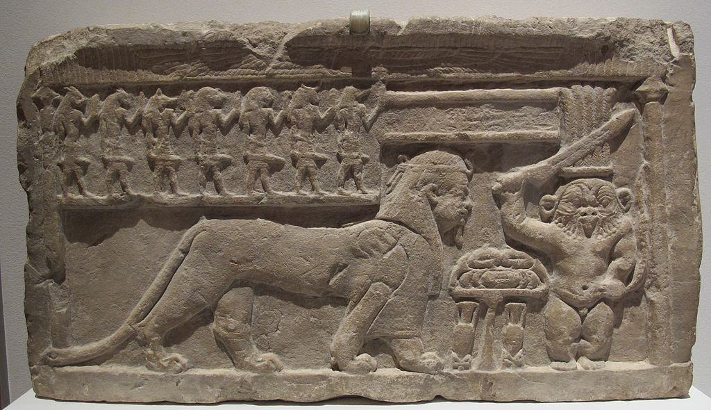 Bes confronts a sphinx in this bas relief from the Ptolemaic era
