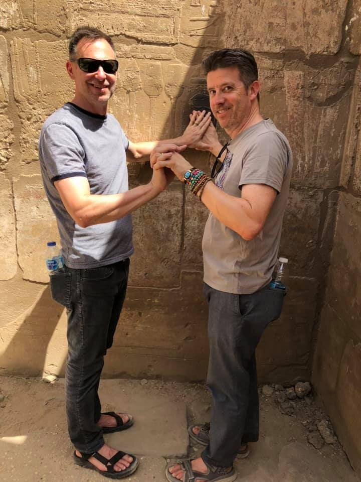 When a policeman has you hold hands as part of a bizarre, elaborate ritual at the back of Luxor Temple, you go along with it. And you tip him afterward