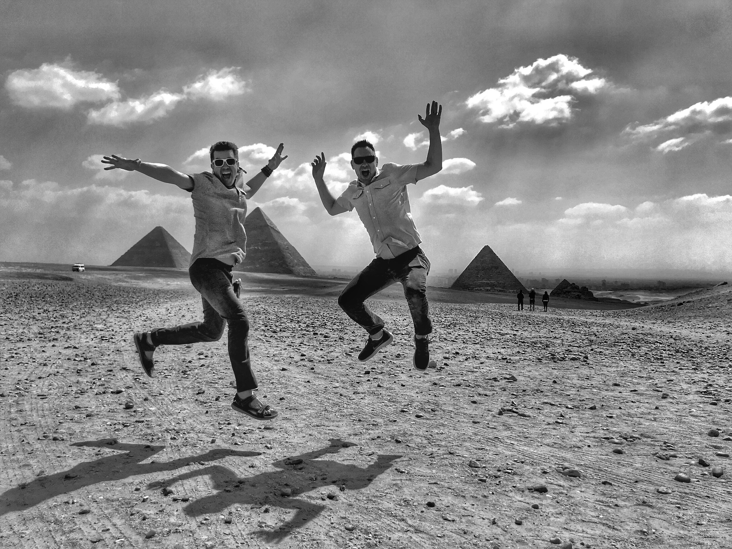 Wally and Duke pretend to jump for joy during their visit to the Giza Necropolis — but really their guide made the experience quite unpleasant