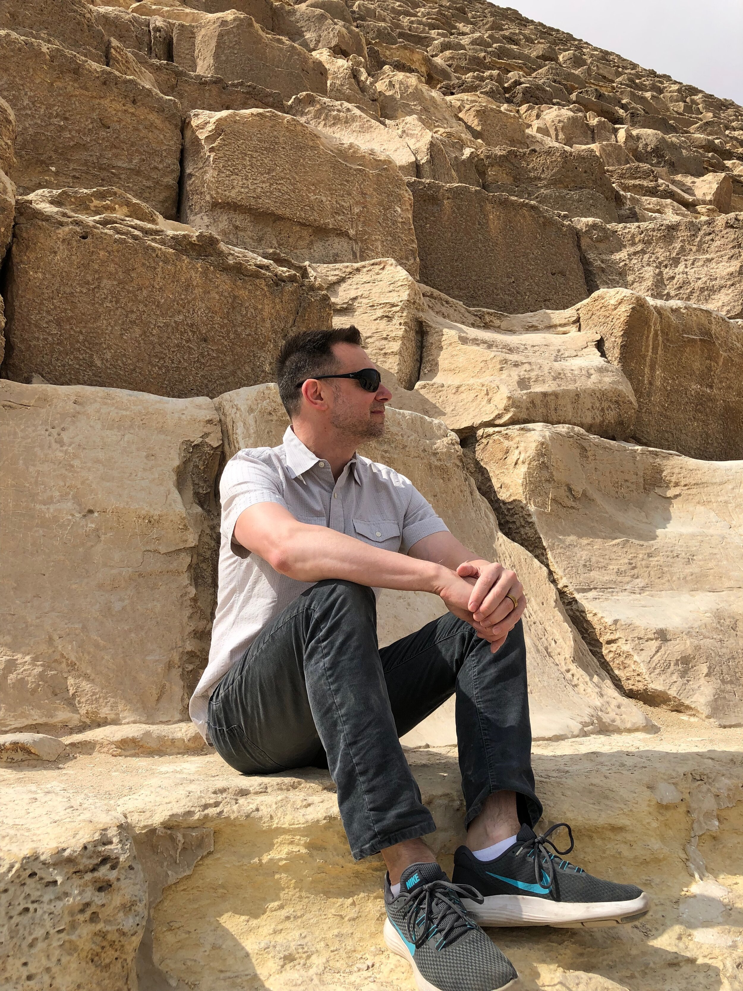 Duke sits at the base of the Great Pyramid. Wally says the pyramids are full-on Monets: gorgeous from afar…but a big old mess when you get up close