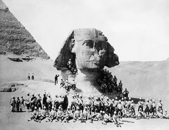 British soldiers pose at the base of the still-buried and noseless Sphinx