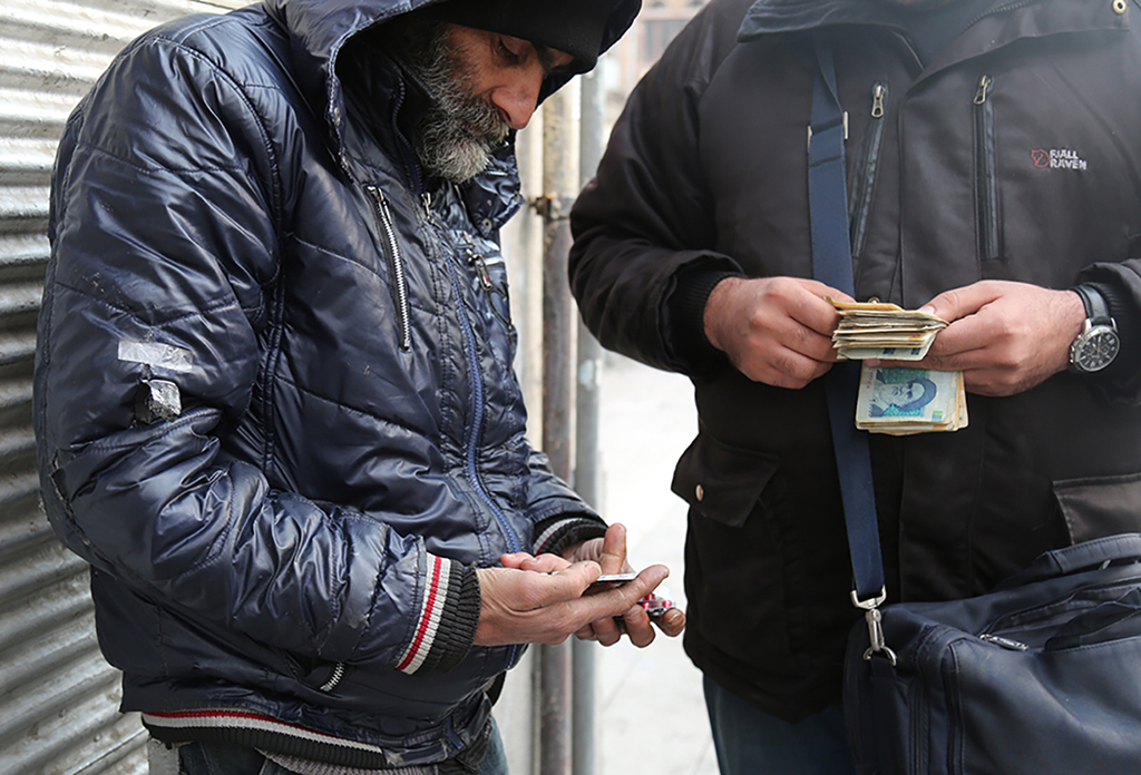 A black market medicine peddler sells foreign drugs on Anvari Street in Shiraz. Photo by Mohammad Mehdipour