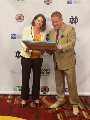 Kathleen Keifer with Notre Dame Coach Brian Kelly