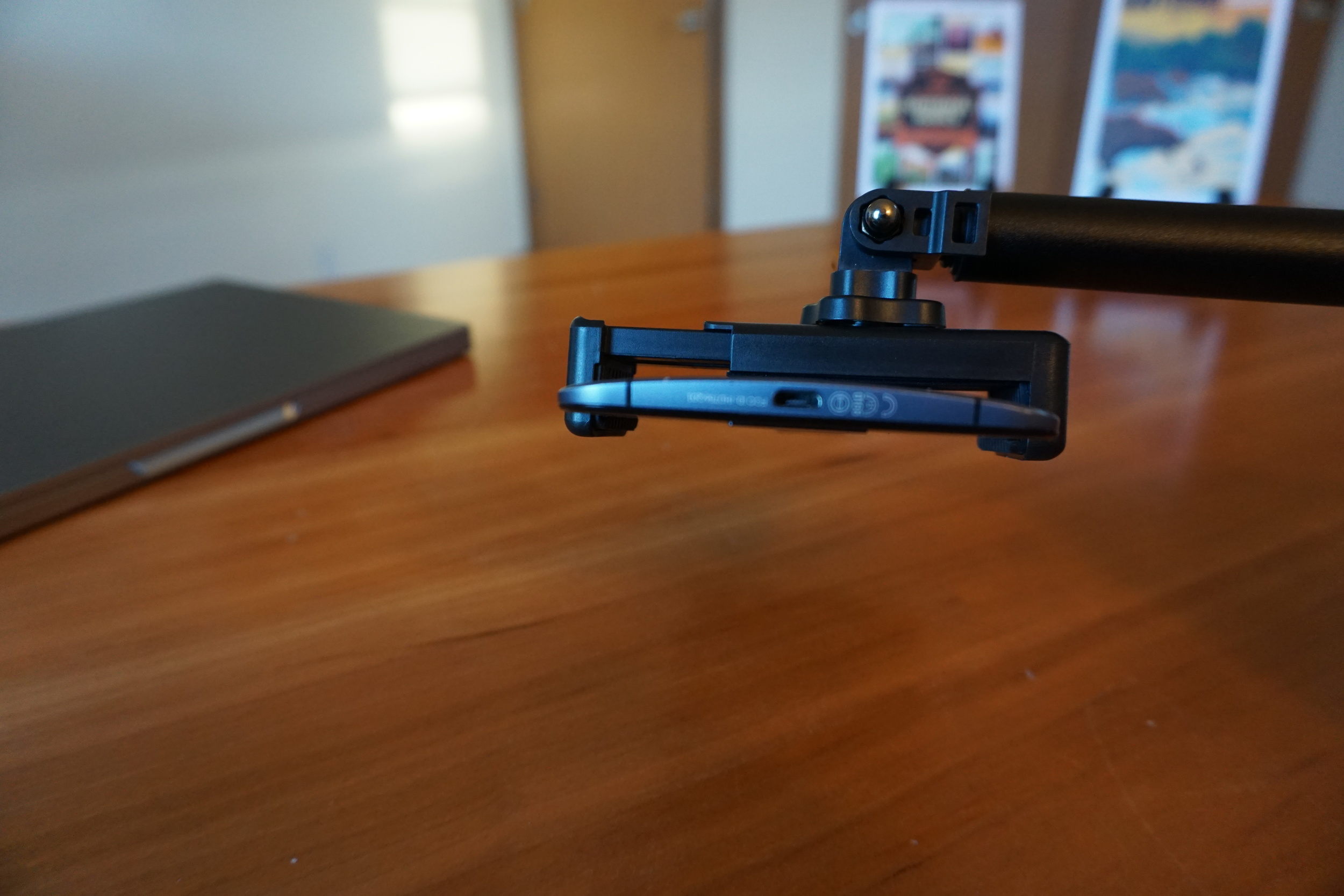 Profile shot of Nexus 6 in the phone holder adapter which is included with the XShot Sport Camera Extender Pole