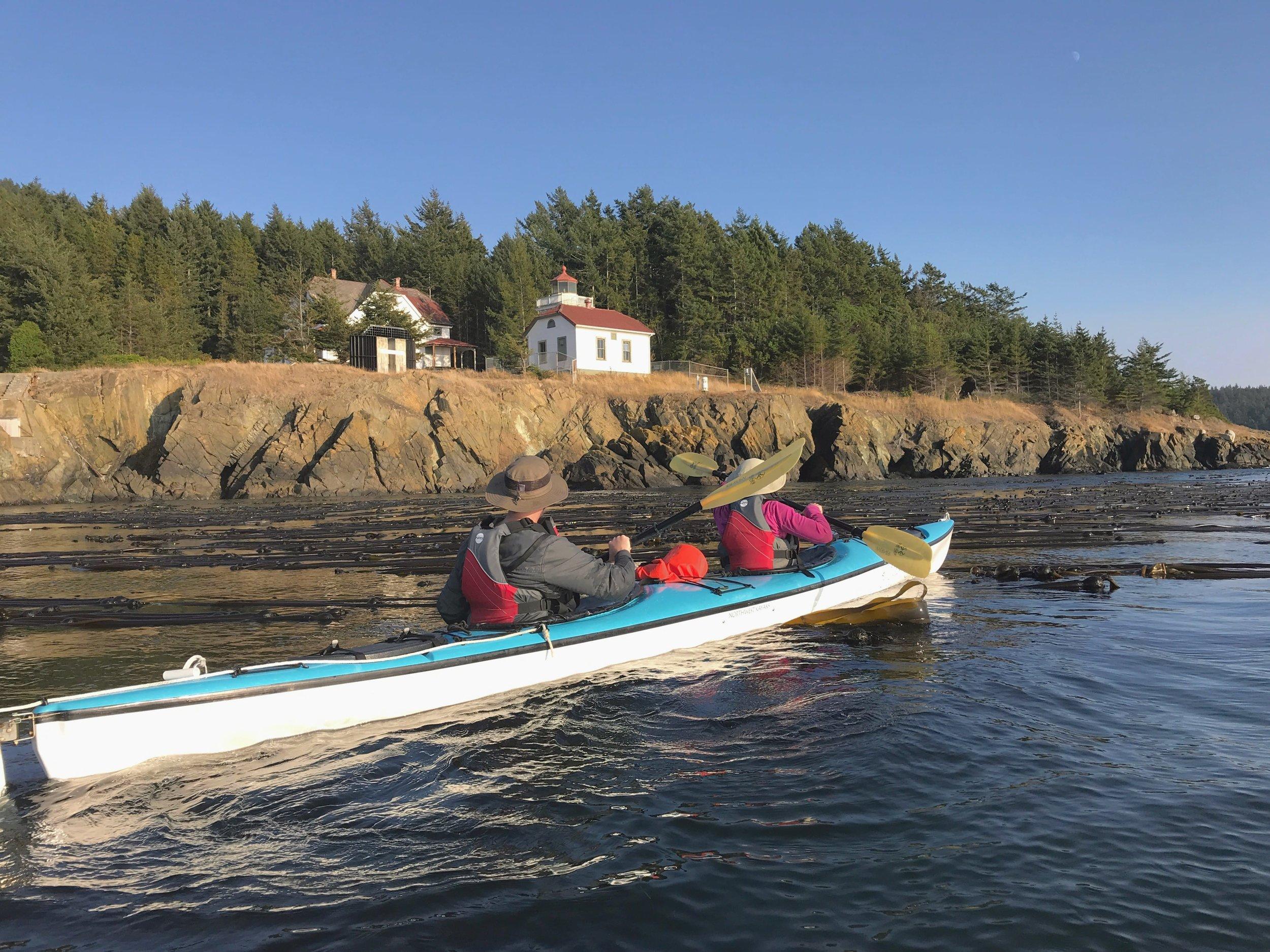 Kayaking past Burrows Island Lighthouse