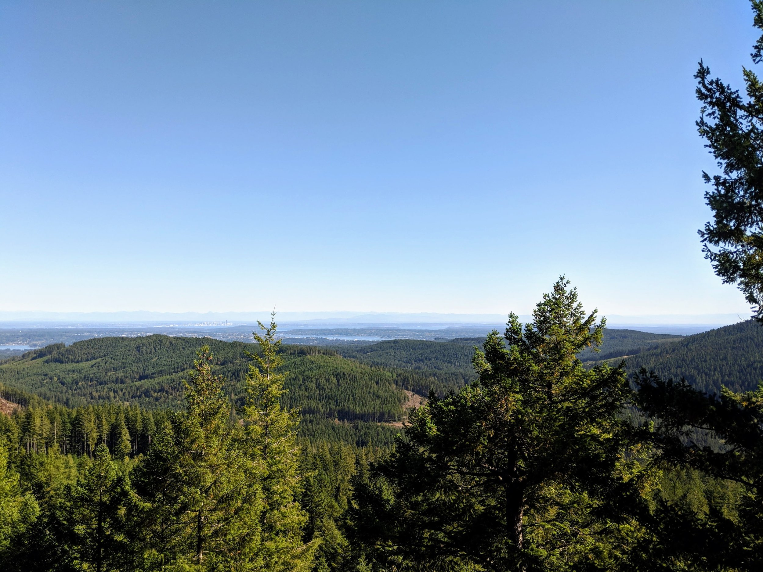 Distant views of Seattle and the Cascade Mountains from Green Mountain