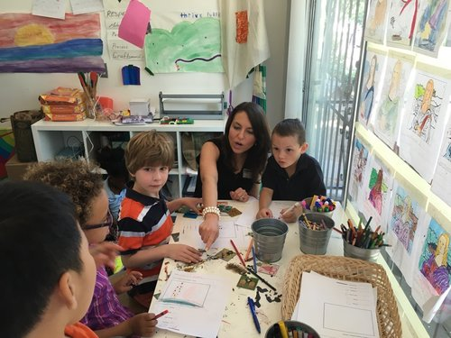 Indigo CEO Sheri Smith works with elementary school students.