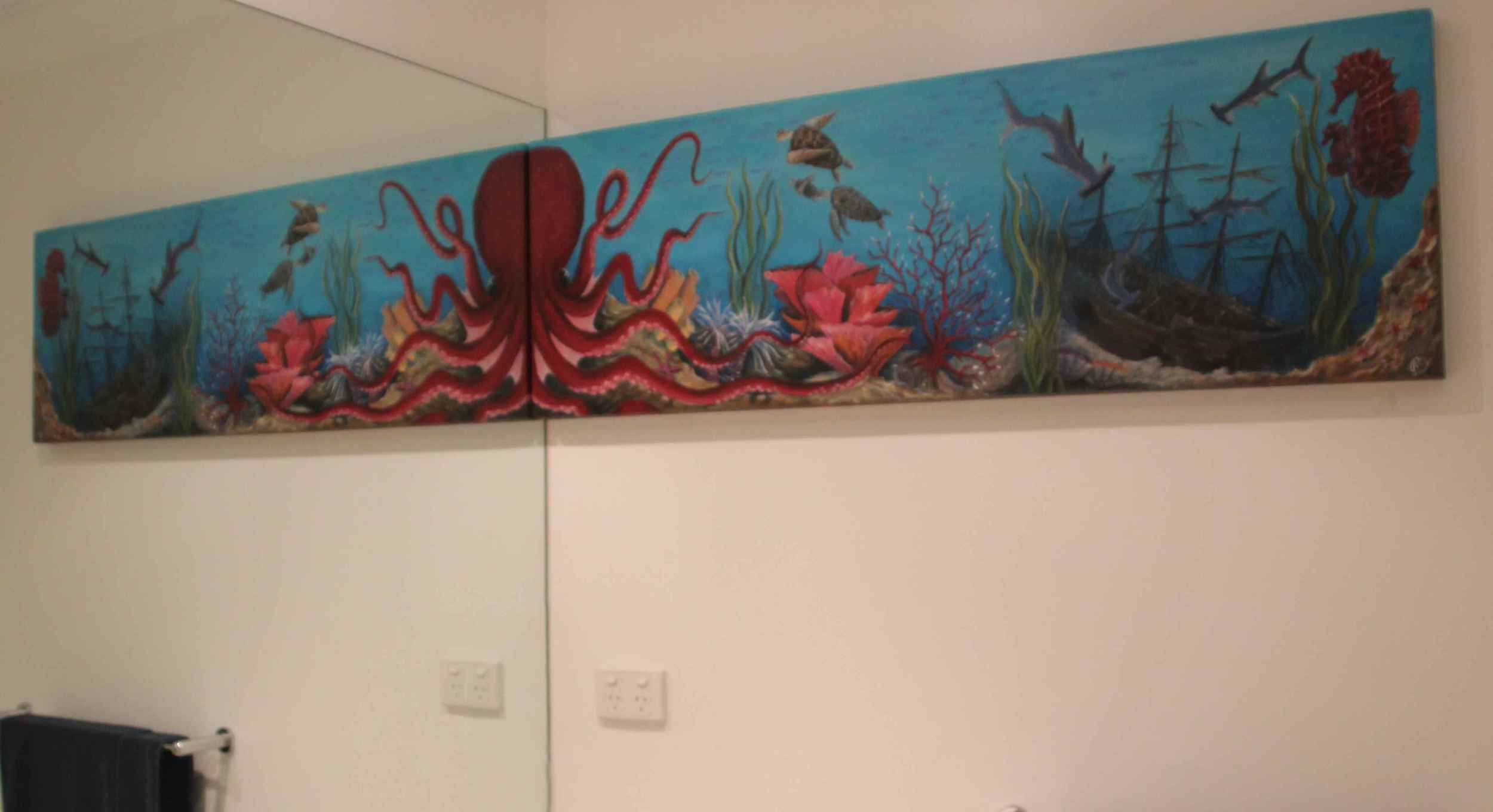 This piece was made to take advantage of the large wall next to the mirror in this bathroom. The idea firstly started with the octopus reflecting in the mirror to become full size, with an underwater world behind it. This was a really enjoyable piece to create and to research all the different marine creatures / coral that fill up the canvas.