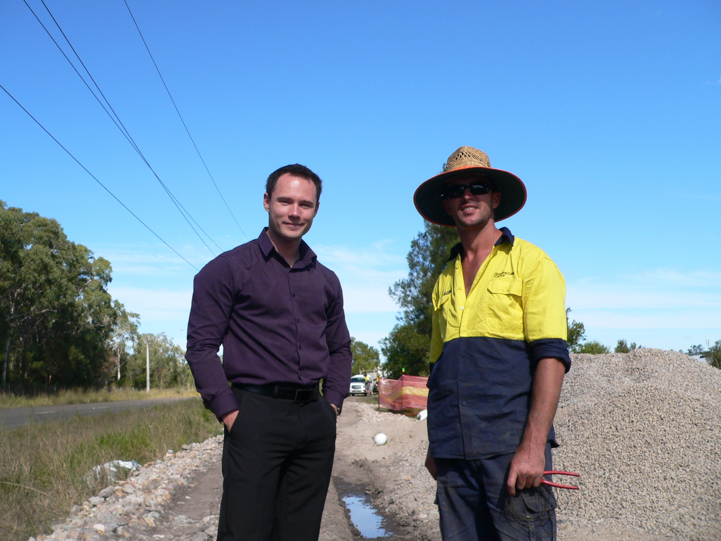 Construction worker Freddie and Cr Christian Dickson on the Claymore Road Cycleway, due for completion in August.JPG