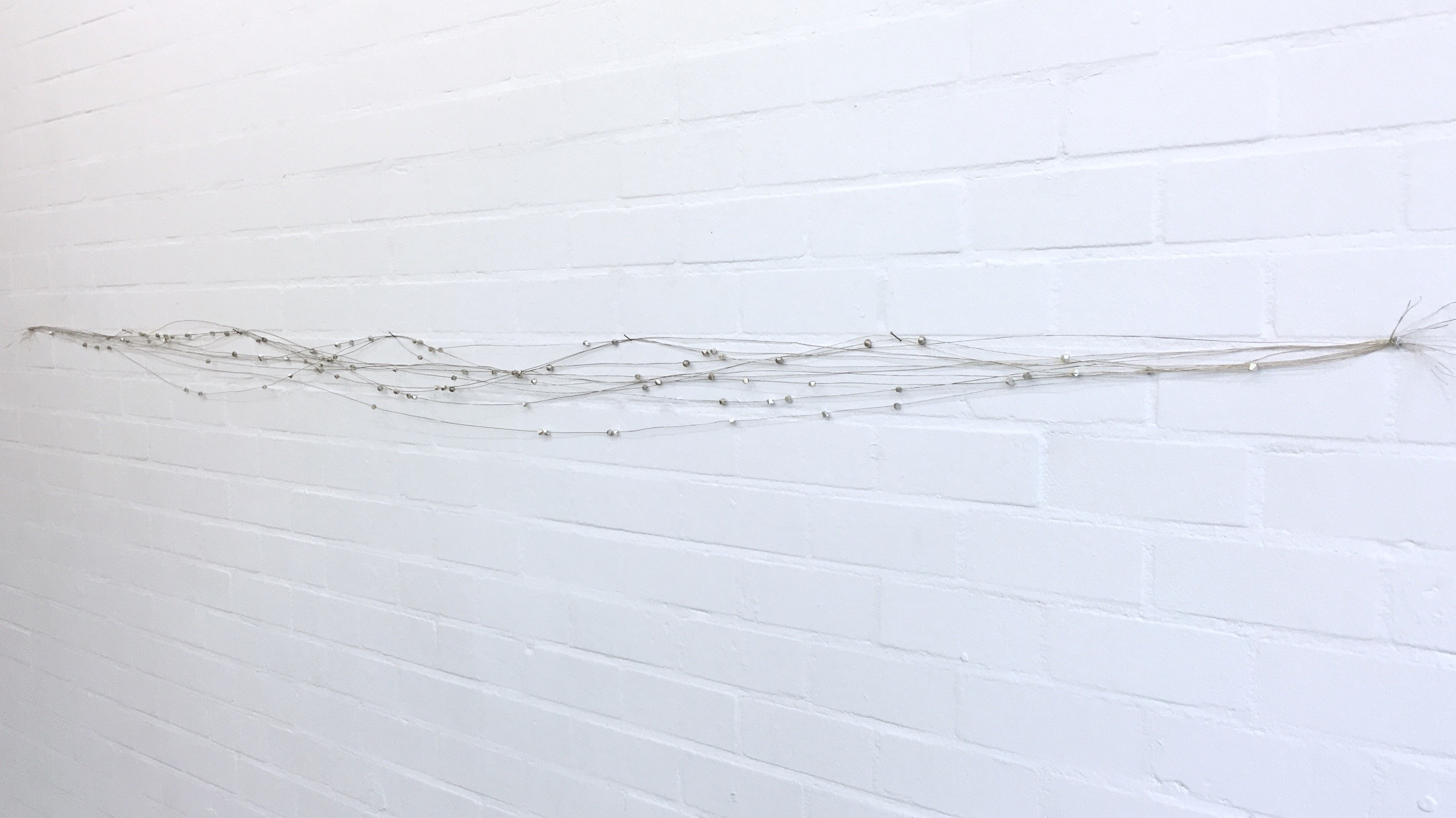 io/io/io/io  ,   roib,   Délia Sheehy, and Marcella.B (silver wire, and silver pearls), 2015. detail,      Joey Ramone Gallery  , Rotterdam  . photo: Paulo Sudo.