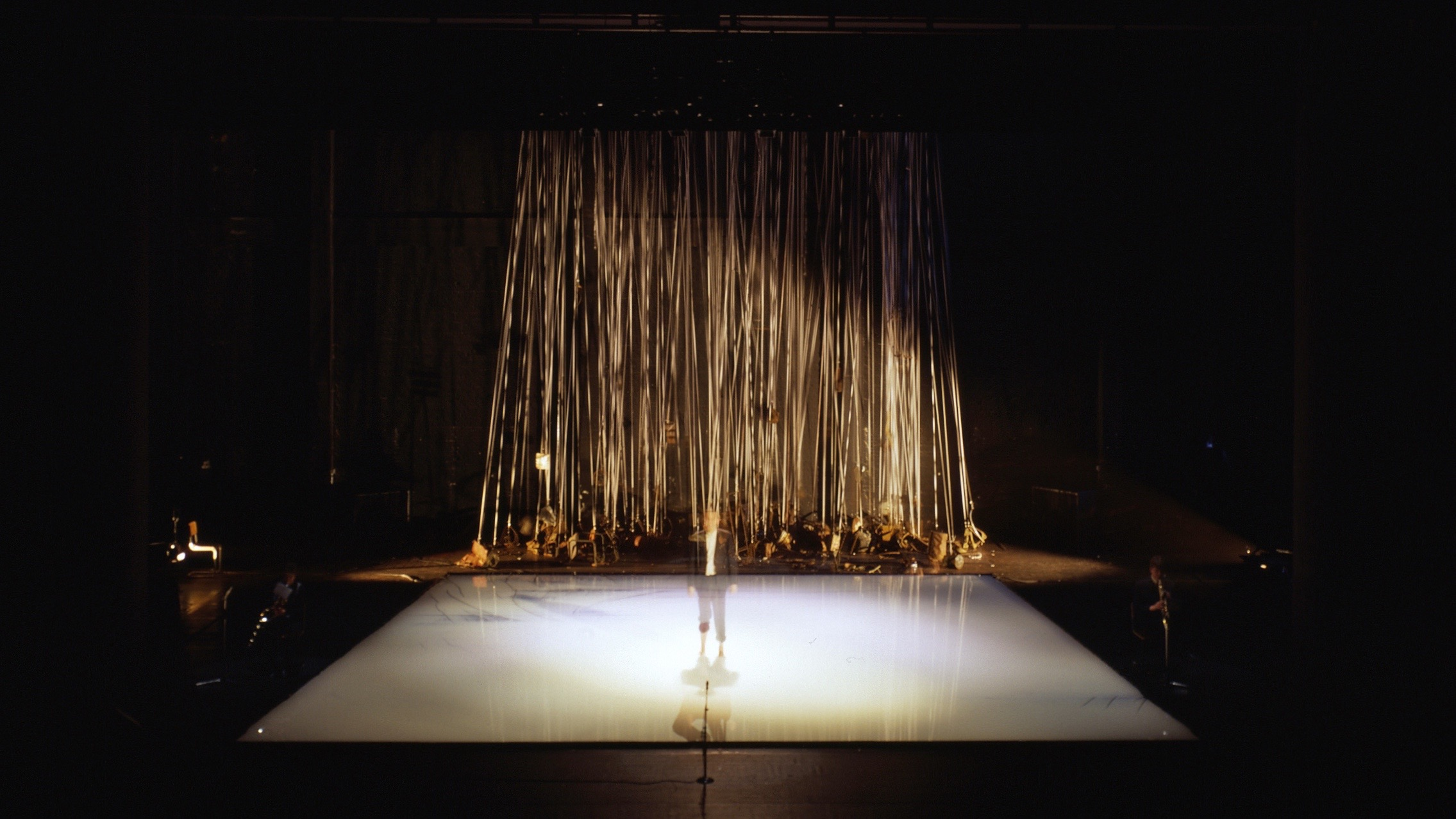 Trudo Engels (& Blindman). It's Raining Tools/Momentum, 1992, 4 saxes, 400 liters of milk, 1 ton of scrap, 3 km of elastic, lesson 23, and the weather report of December 20. Installation view at Aeronef, Lille, France