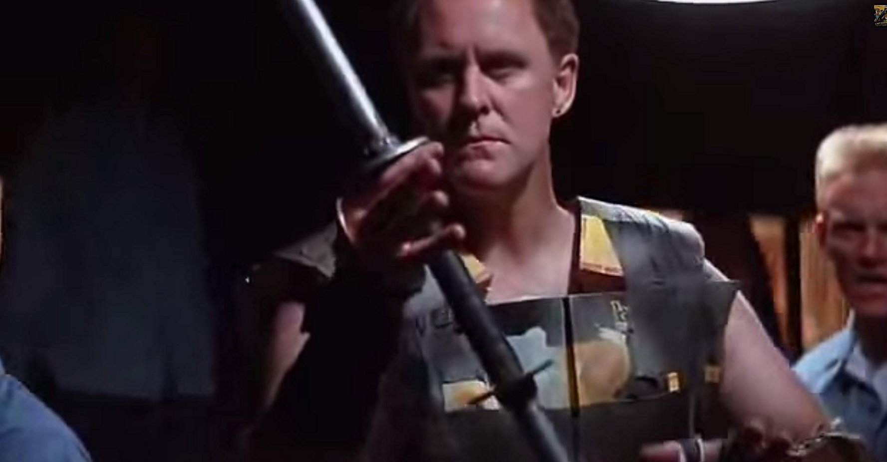 Why yes that is John Lithgow in phonebook armor weilding a makeshit sword.