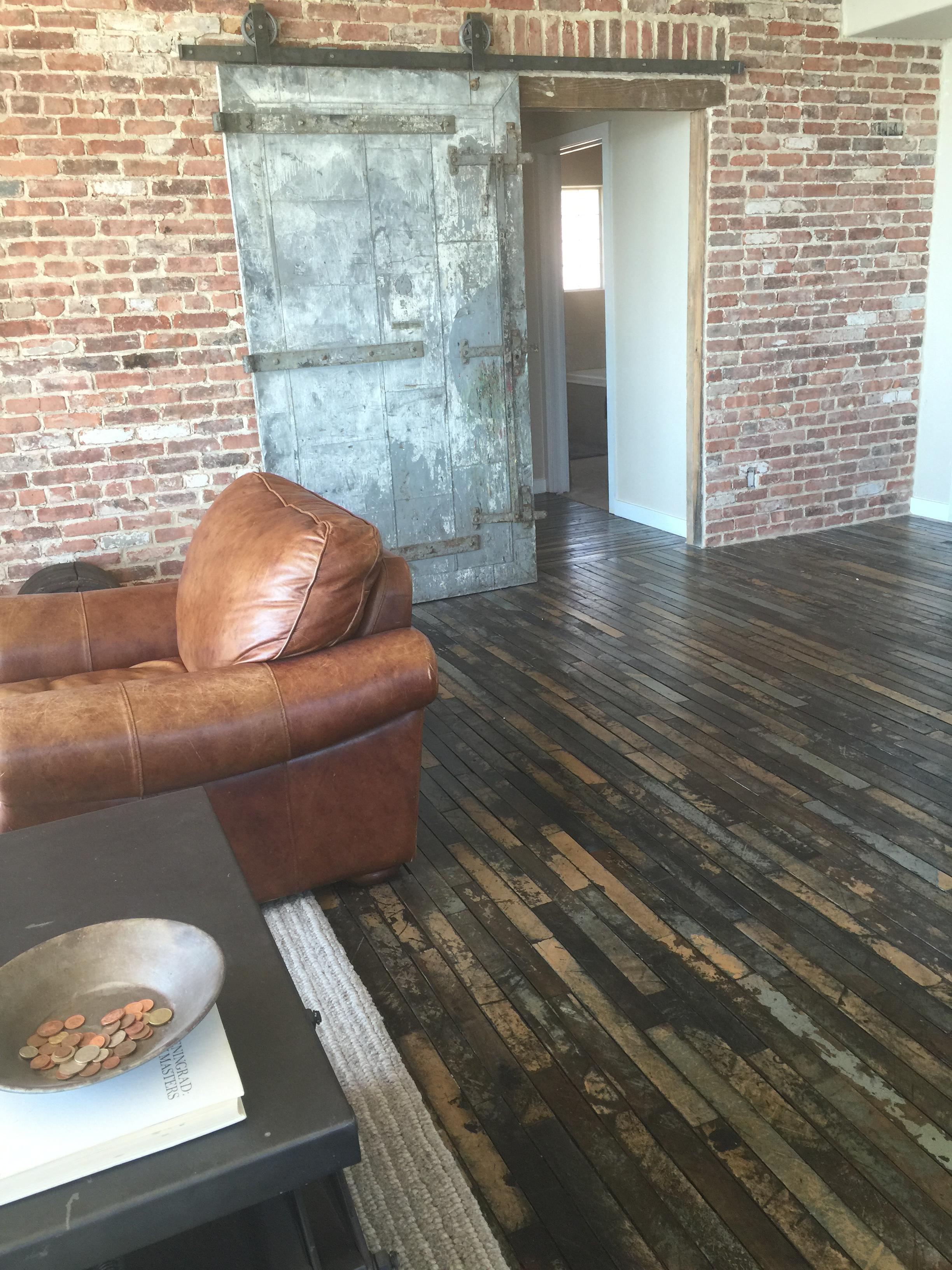 fire door, factory plank maple floors, reclaimed brick.JPG