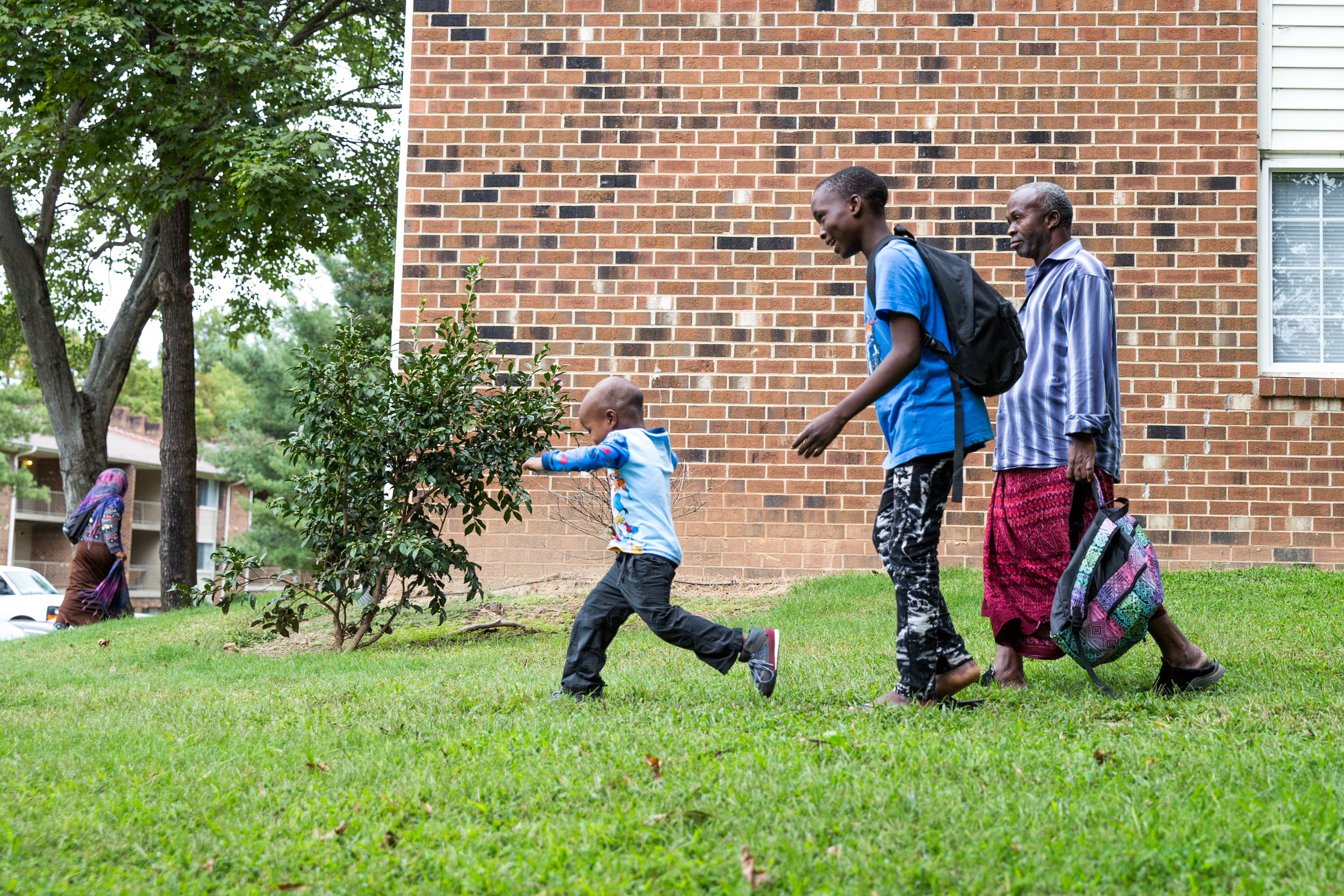 Fartune, Asimani, and Ali get dropped off from school. They haven't found anybody who speaks Swahili, so making friends has been difficult.