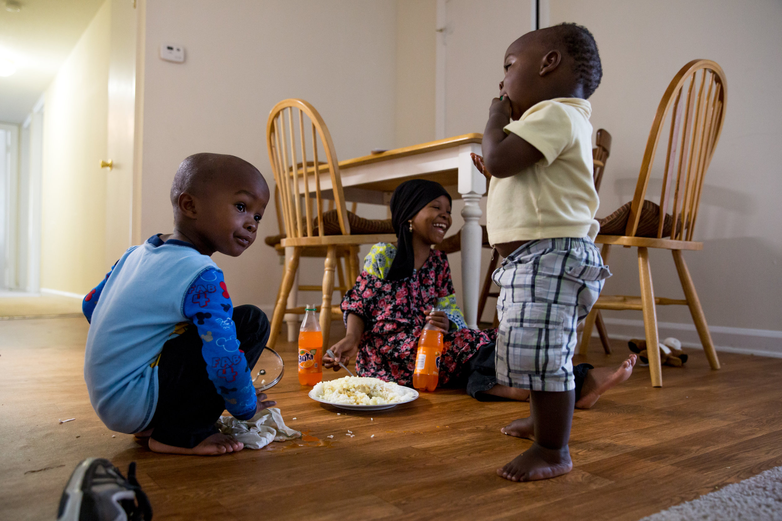 The family rarely uses tables. After eating on the ground in Kenya for 12 years, they still prefer the floor.