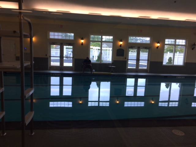 Indoor pool at Central Park at Victoria Falls.  You an see the outdoor pool beyond it.