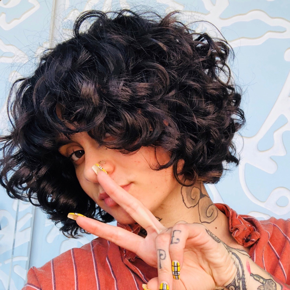 Curly Bangs are Back and Cute as Ever - Bangs are a bold beauty choice, and curly hair girls can wear them too!