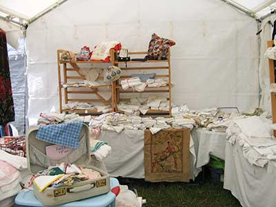 Brimfield antique booth - vintage linens