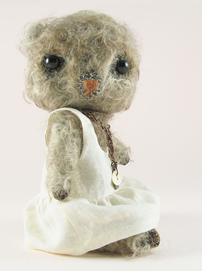 Celie in white linen dress side view