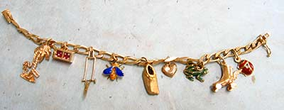 gold charm bracelet with vintage charms