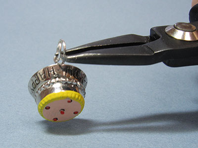 Charm with Link Attached and opened with split ring pliers