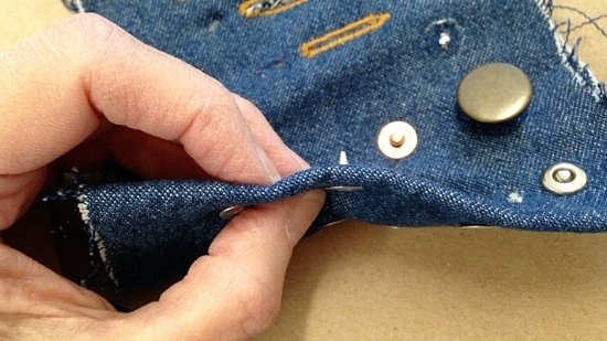 Rivet sticking out of denim too much (denim sample shown here)- needs to be cut down.