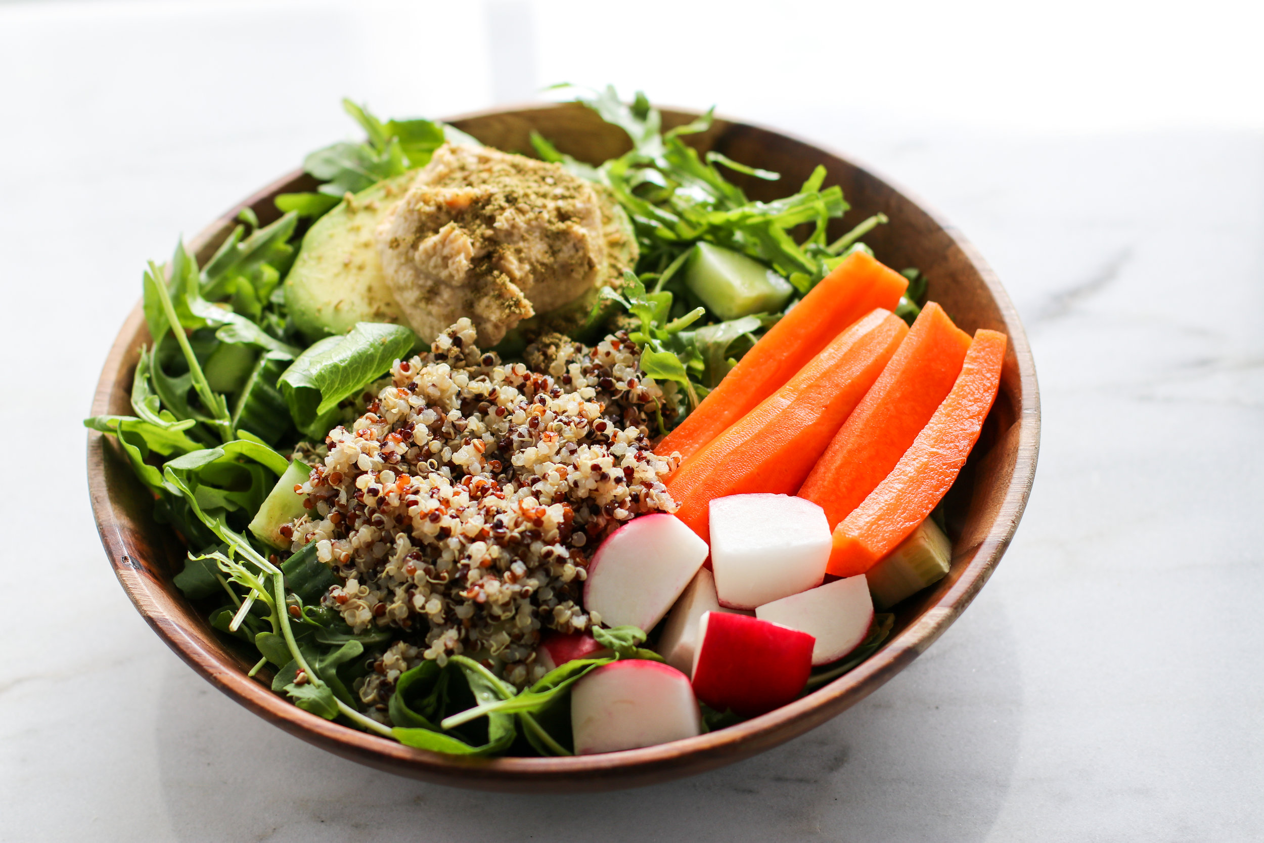 Salad Bowl #1 - I have a salad for lunch most days. Here I've got a bed of arugula + romaine + my house dressing + cucumber + carrots + radish + quinoa + avocado + hummus + za'atar.They look fancy, but honestly come together quickly with everything already chopped in the fridge!