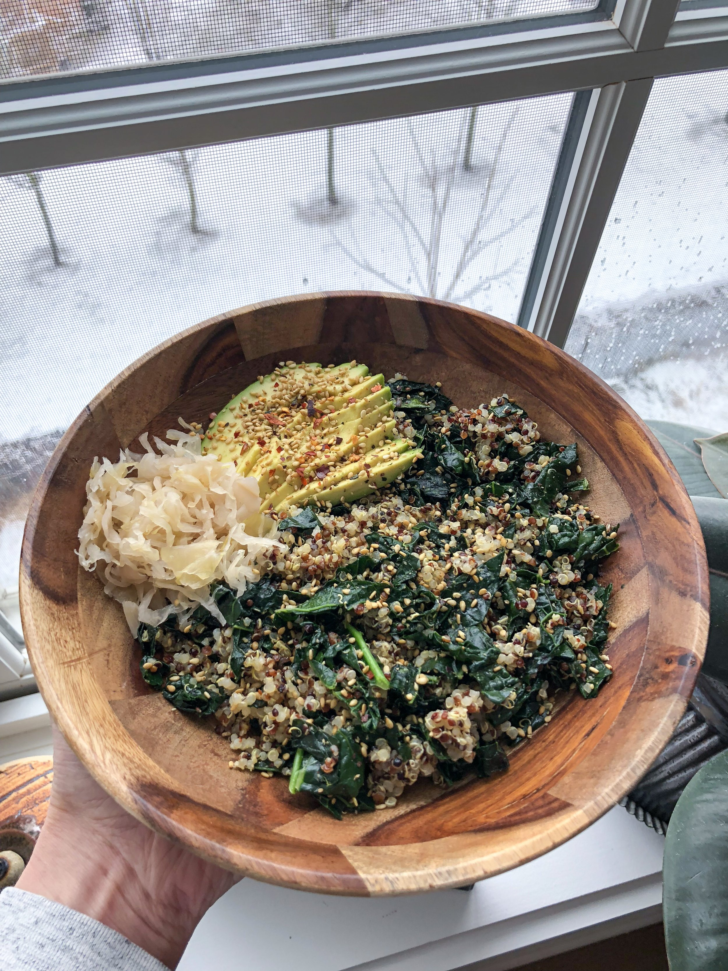 Quinoa and Greens Stir-fry - The snow day last week meant lots of warming bowls. Here I sautéed the chopped kale with a bit of olive oil and coconut aminos until wilted, then added in the cooked quinoa and warmed through. Topped with a good amount of gomasio and served with a side of sauerkraut and avocado.