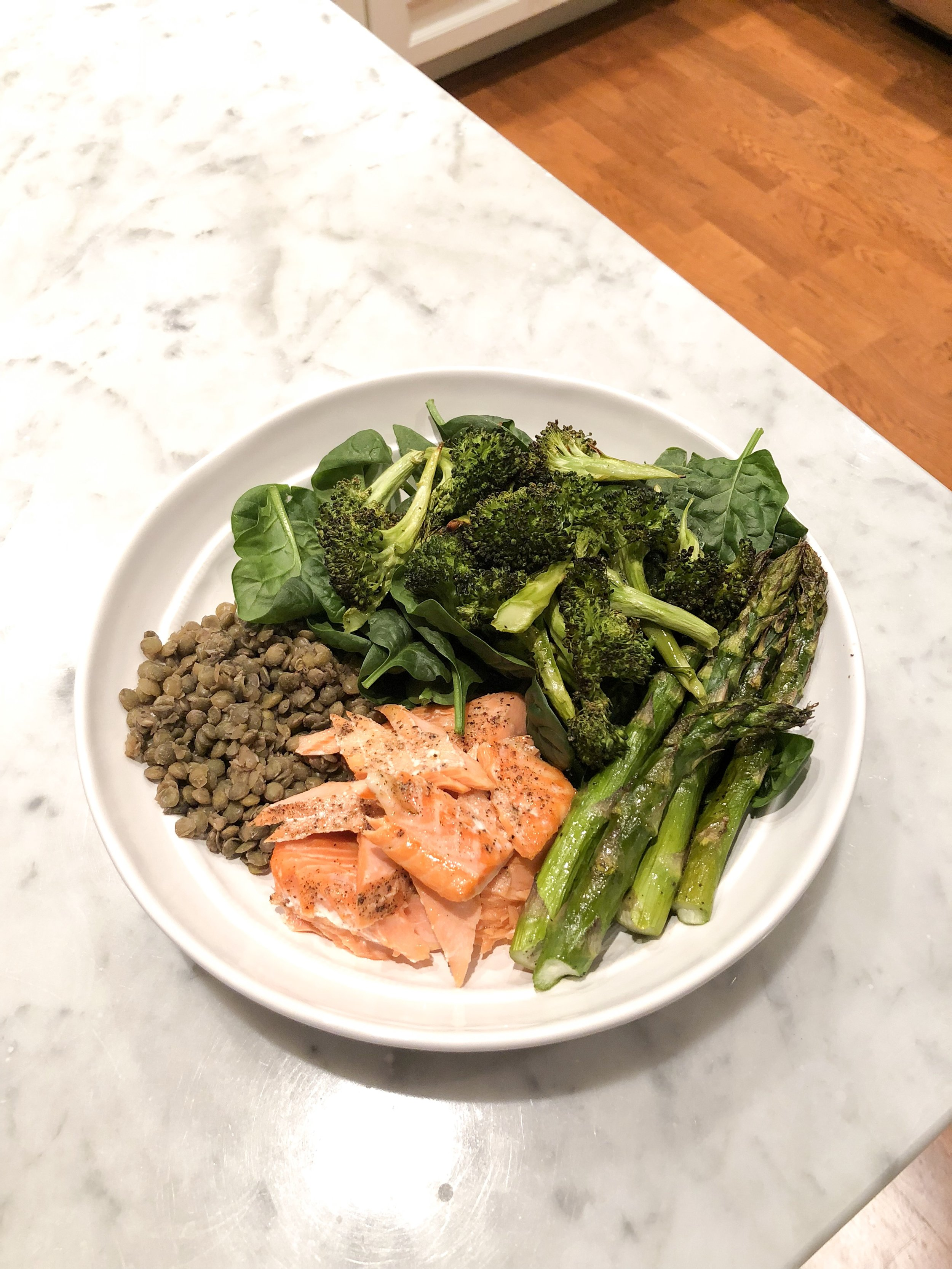 Salmon, Lentils, & Roasted Veggies - I never meal prep my broccoli or asparagus. They take 15 minutes to cook - which just so happens to be roughly the same amount of time it takes to cook salmon. Add a bed of spinach and some meal prep lentils and it's a perfectly balanced plate.Also - have to practice what I preach - notice that half the plate is green!