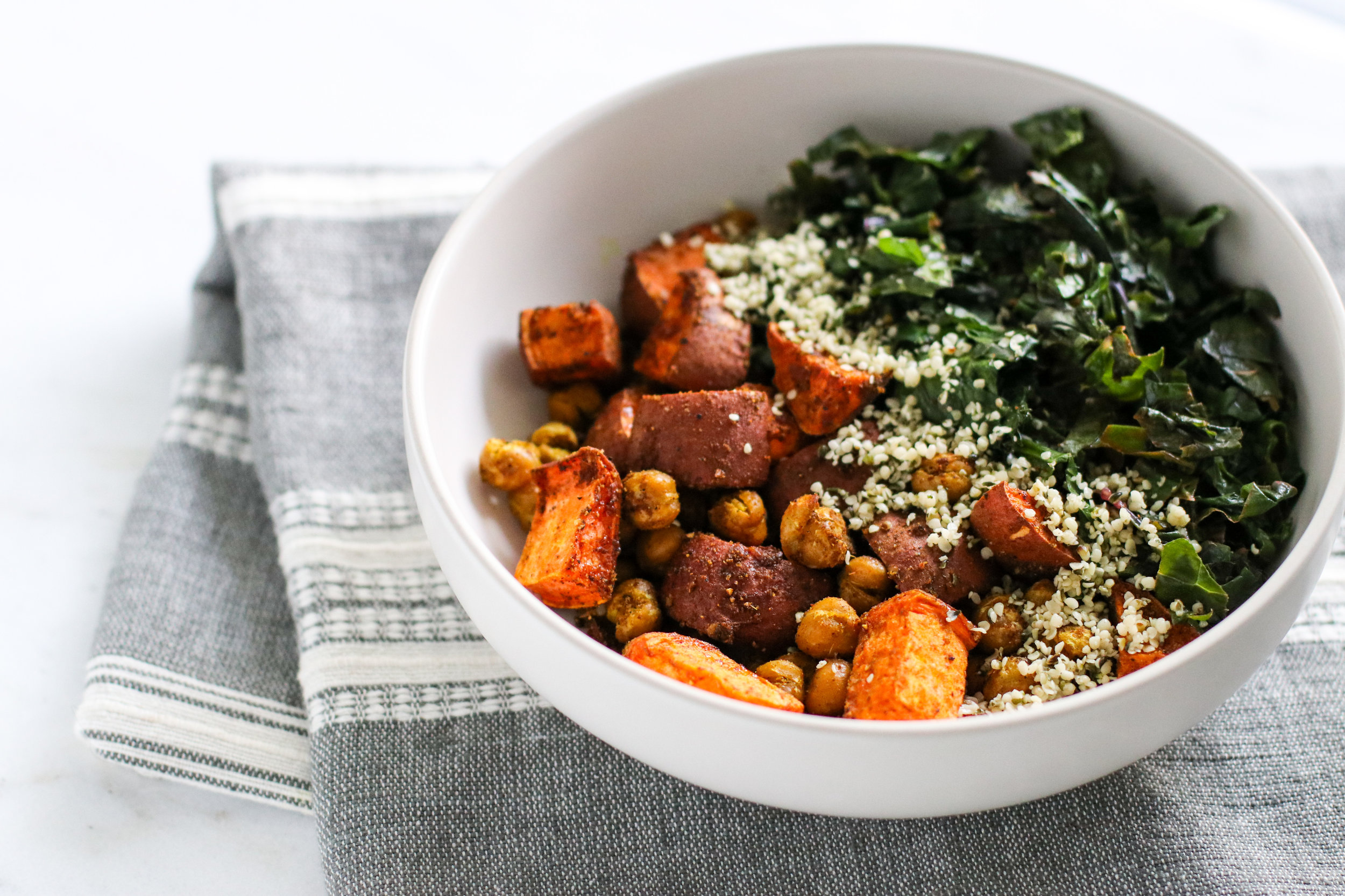 Cumin + Coriander Roasted Sweet Potatoes and Chickpeas over Quinoa with Sautéed Kale and Hemp Seeds