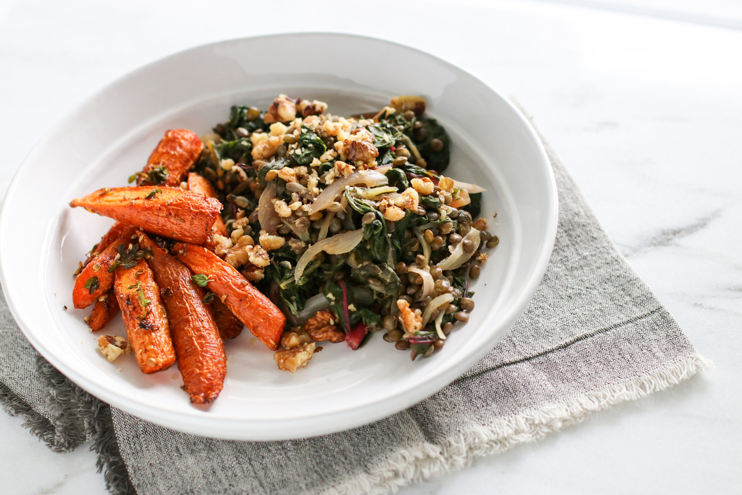 Lentils mixed with Sautéed Swiss Chard and Red Onion with a side of Honey Thyme Roasted Carrots