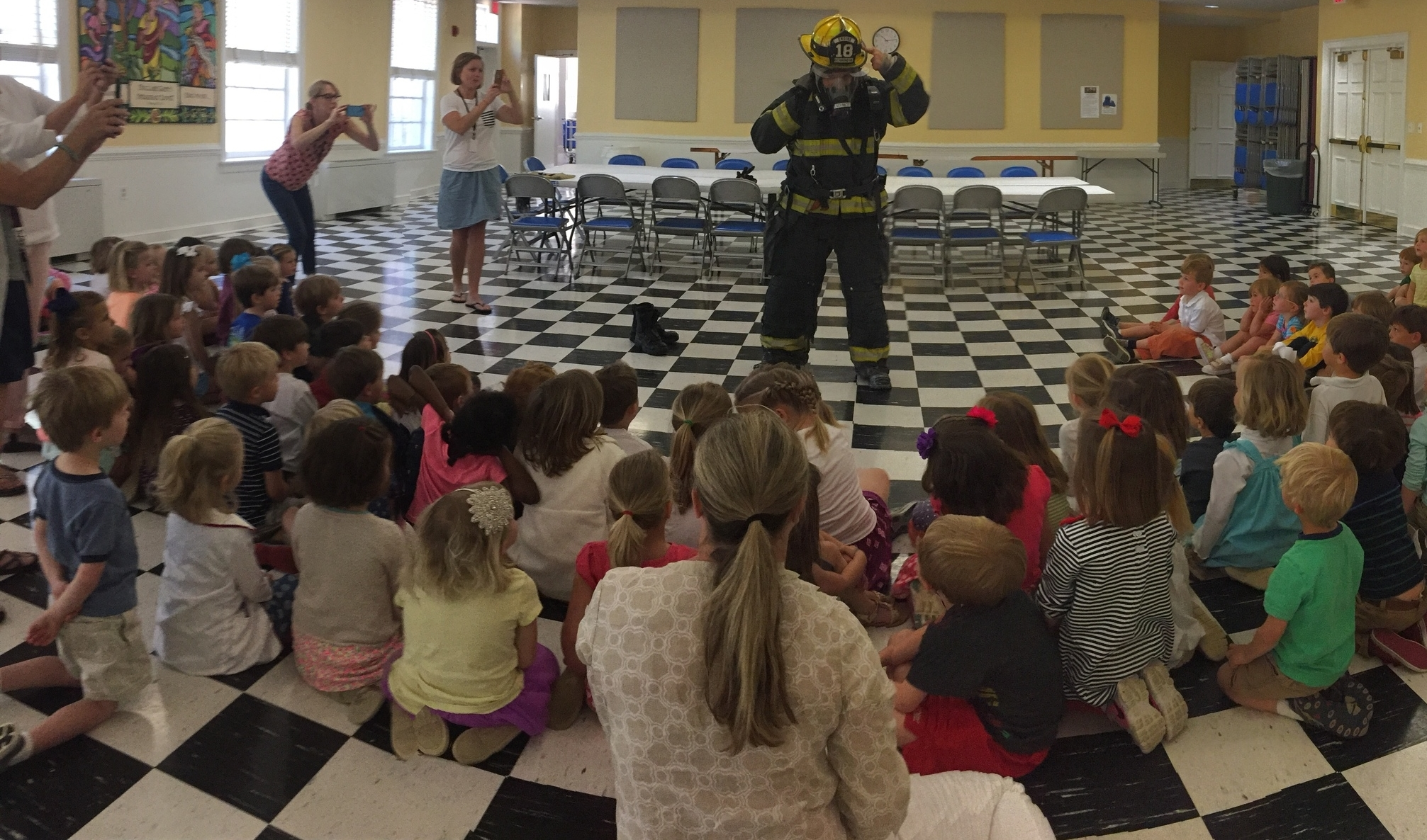 "Groups IV - JK learned all about a day in the life of a firefighter at Station 18.  Now we can name all the parts of a firefighter's ""turn out gear!"""