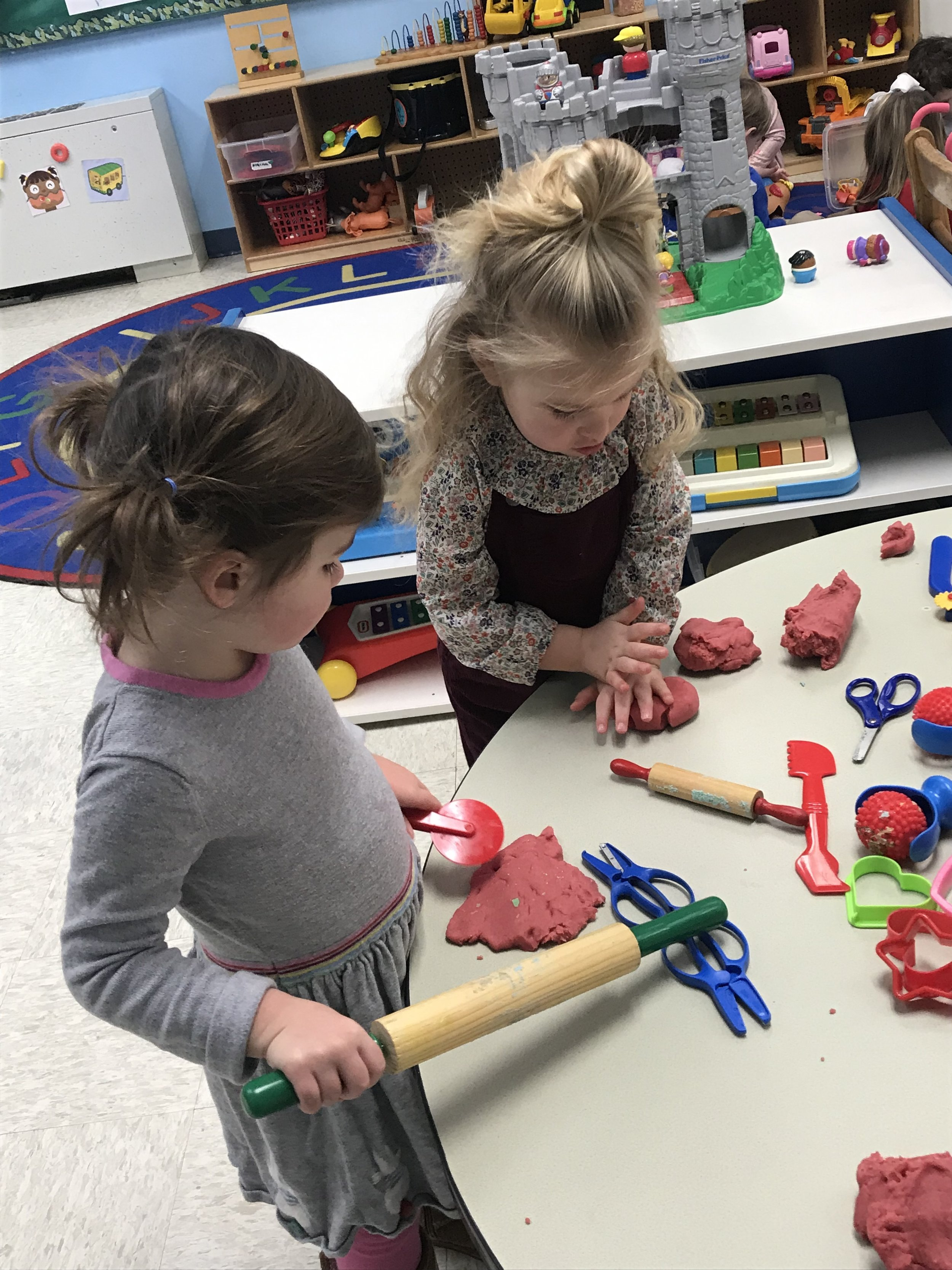 """Annabelle and Whitfield utilizing our new February """"red"""" play-doh."""