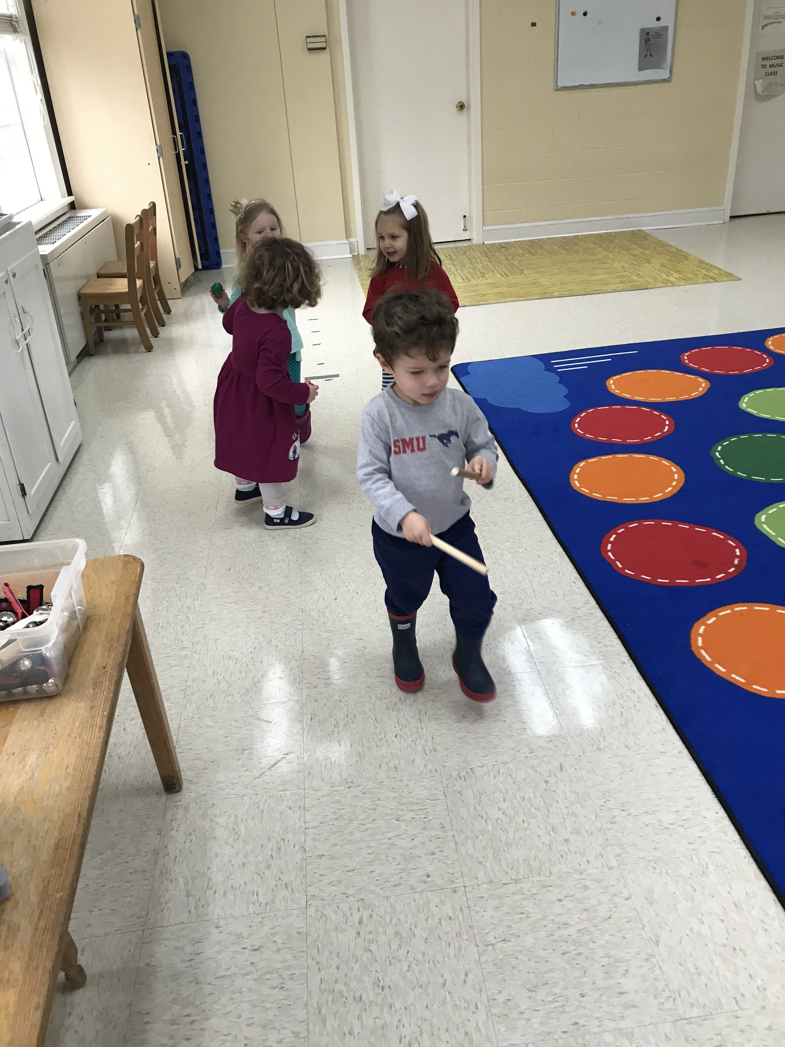 Lots of fun marching like penguins in music class.