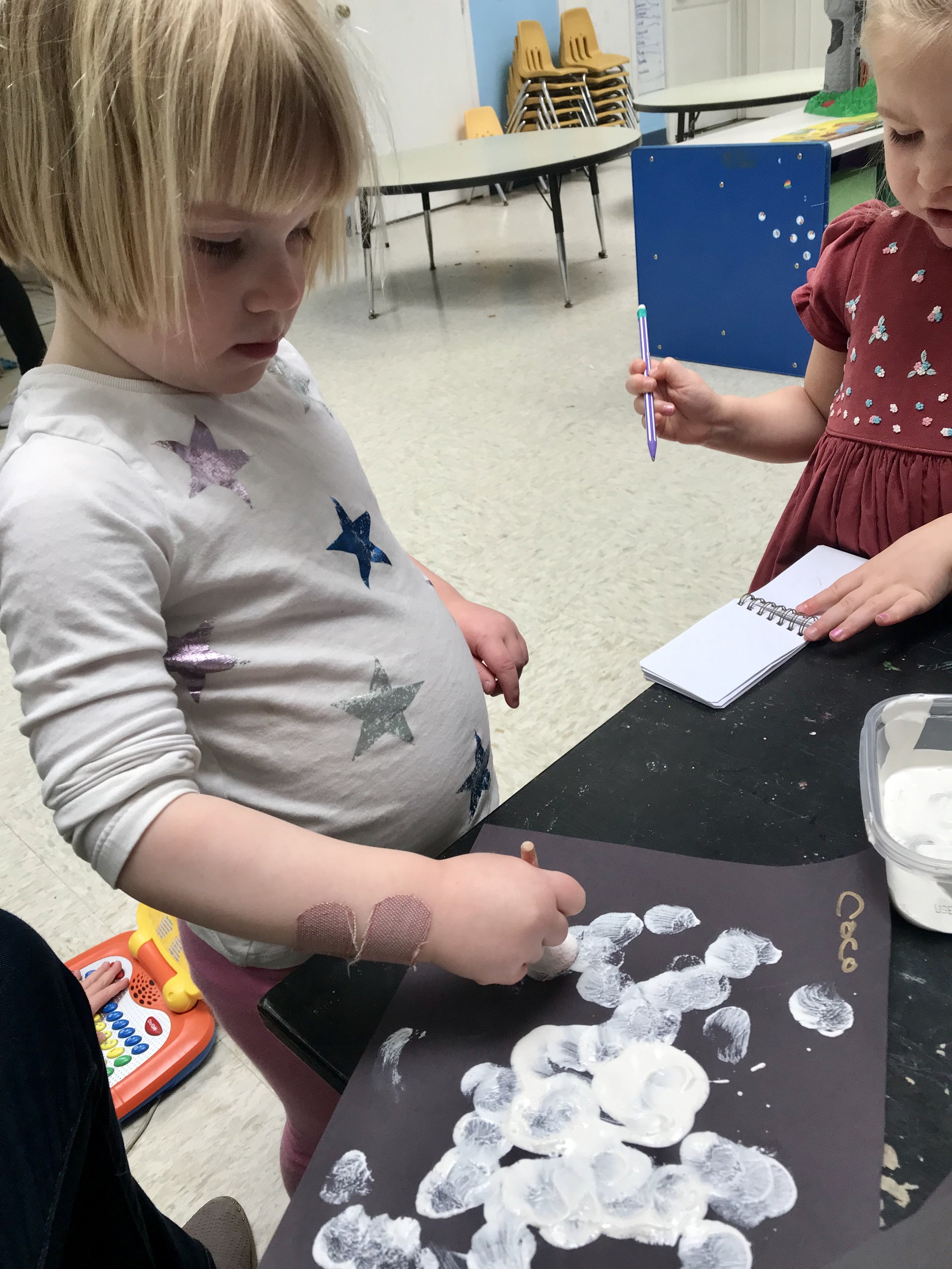 We were working on an art project in keeping with our monthly nursery rhyme (Little Bo Peep).
