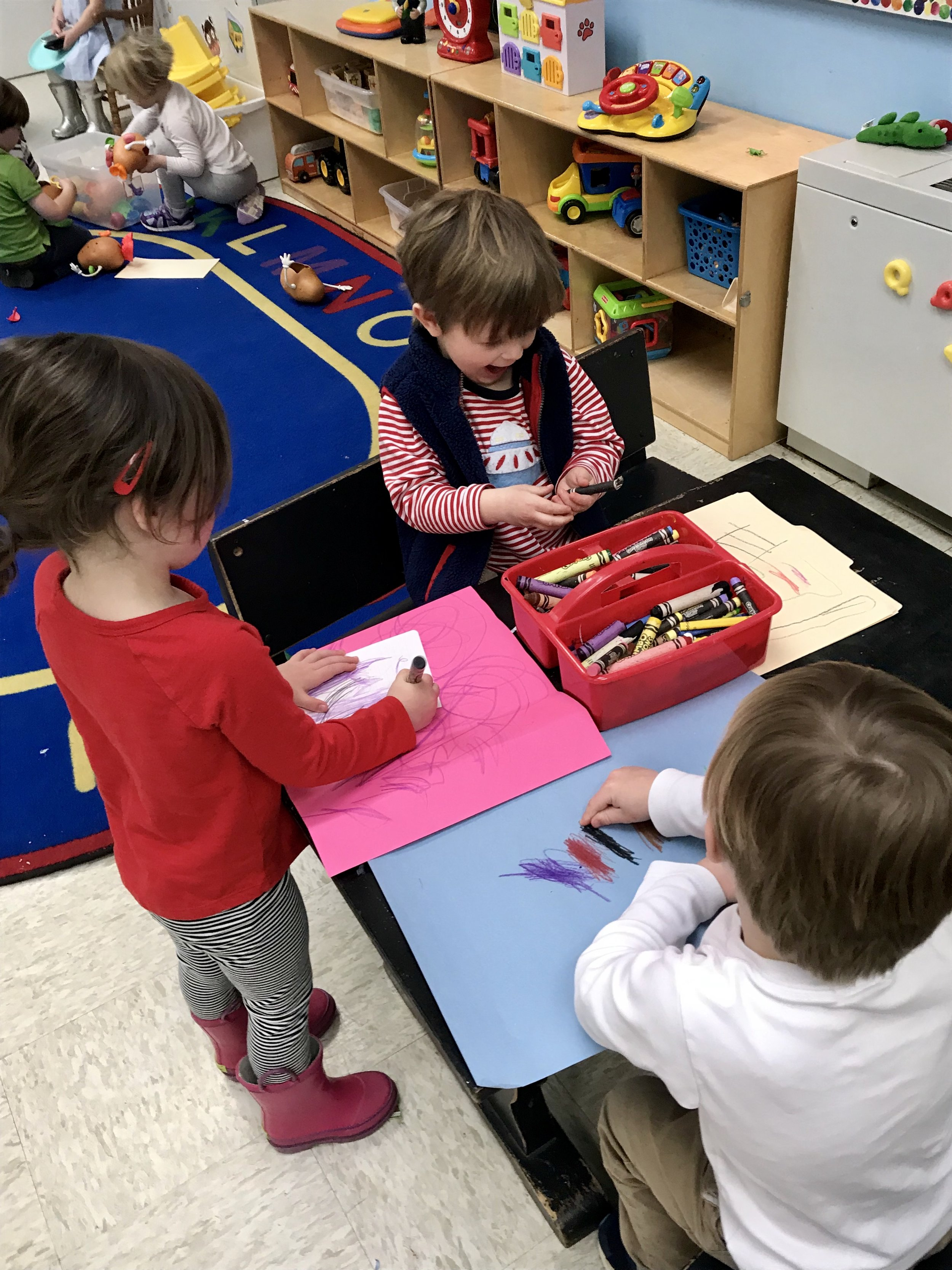 Working as a group to color.