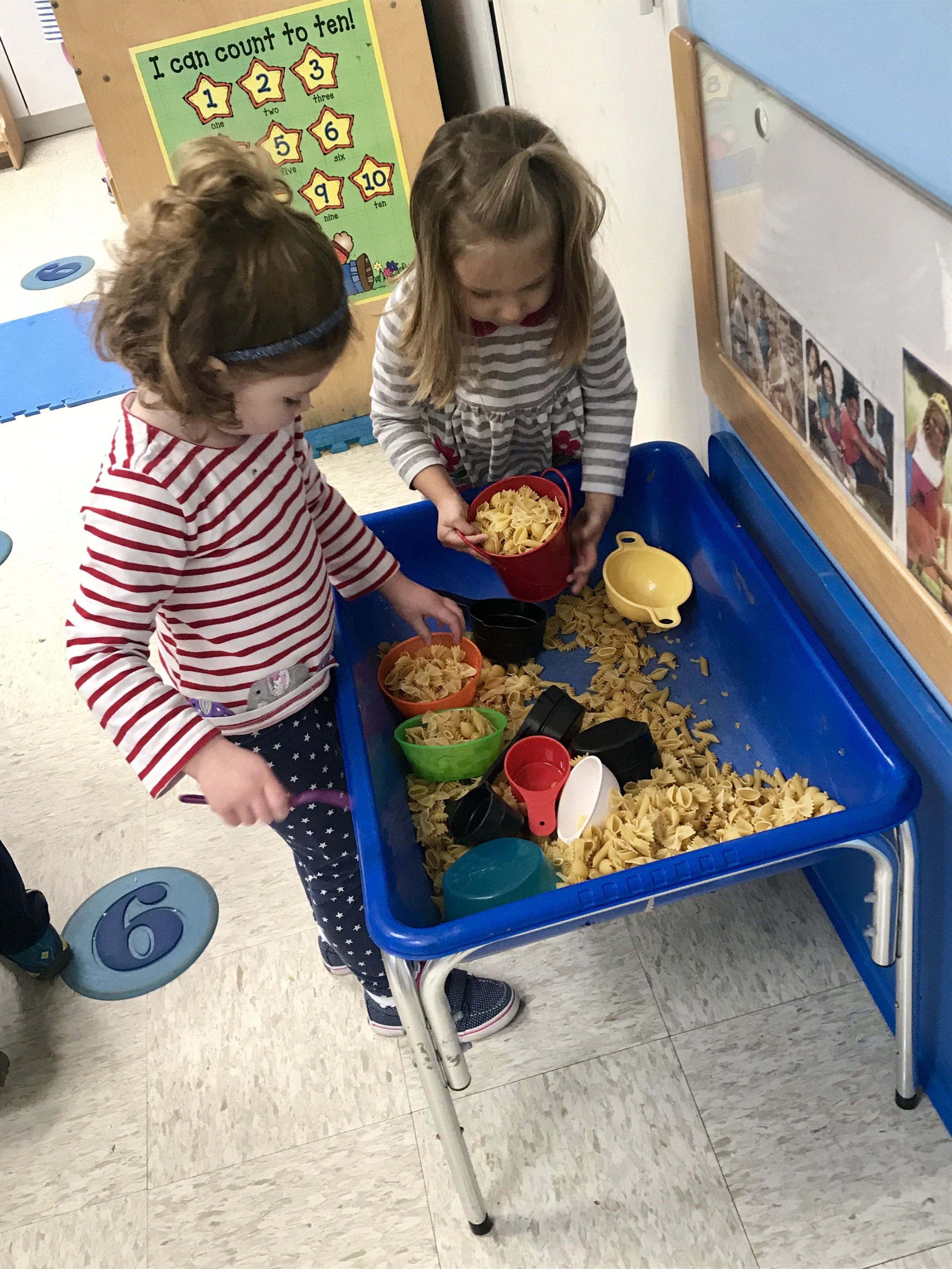 Pasta in the sensory table is great for pouring and measuring.