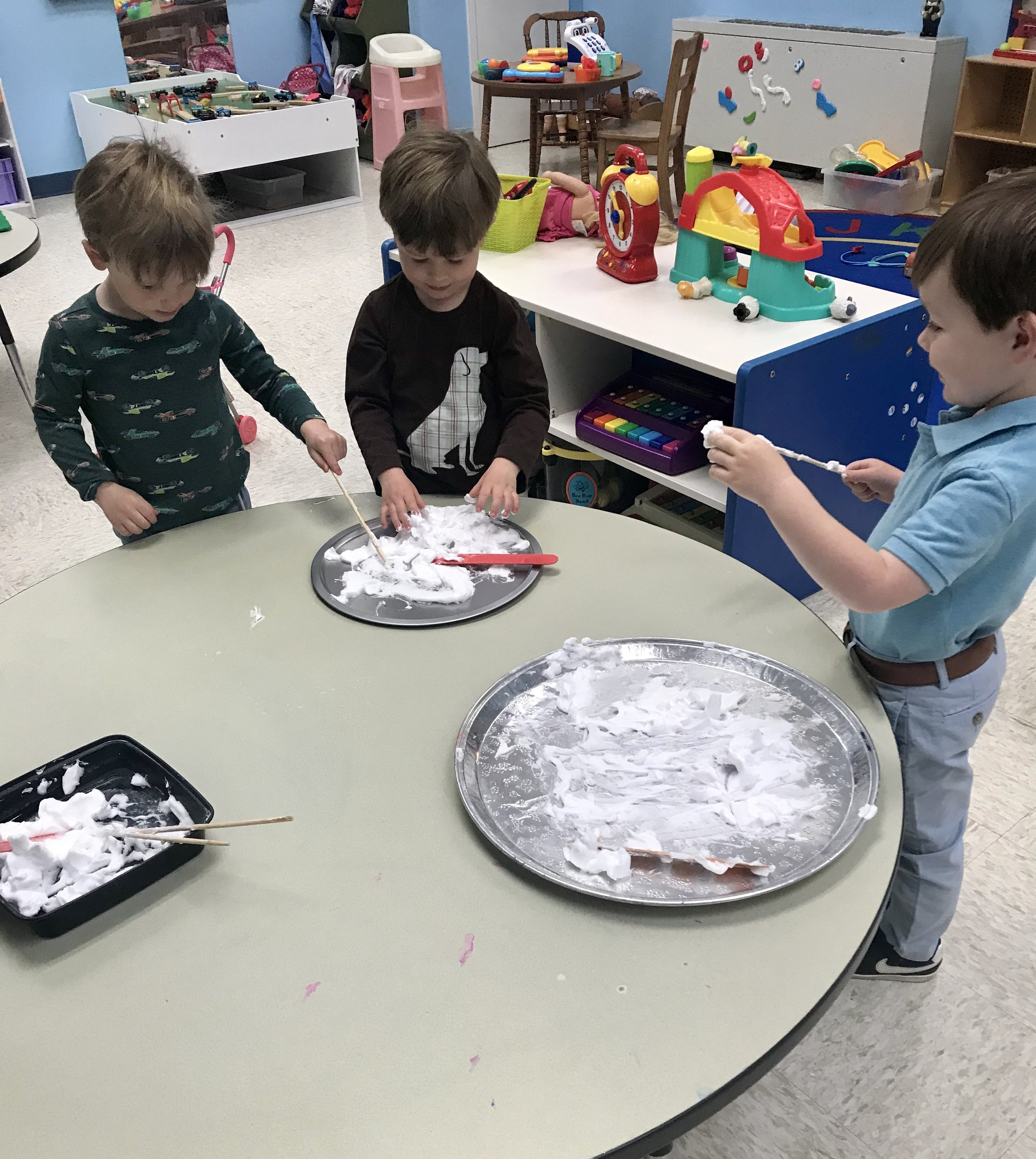 Practicing our first letters by drawing in shaving cream.
