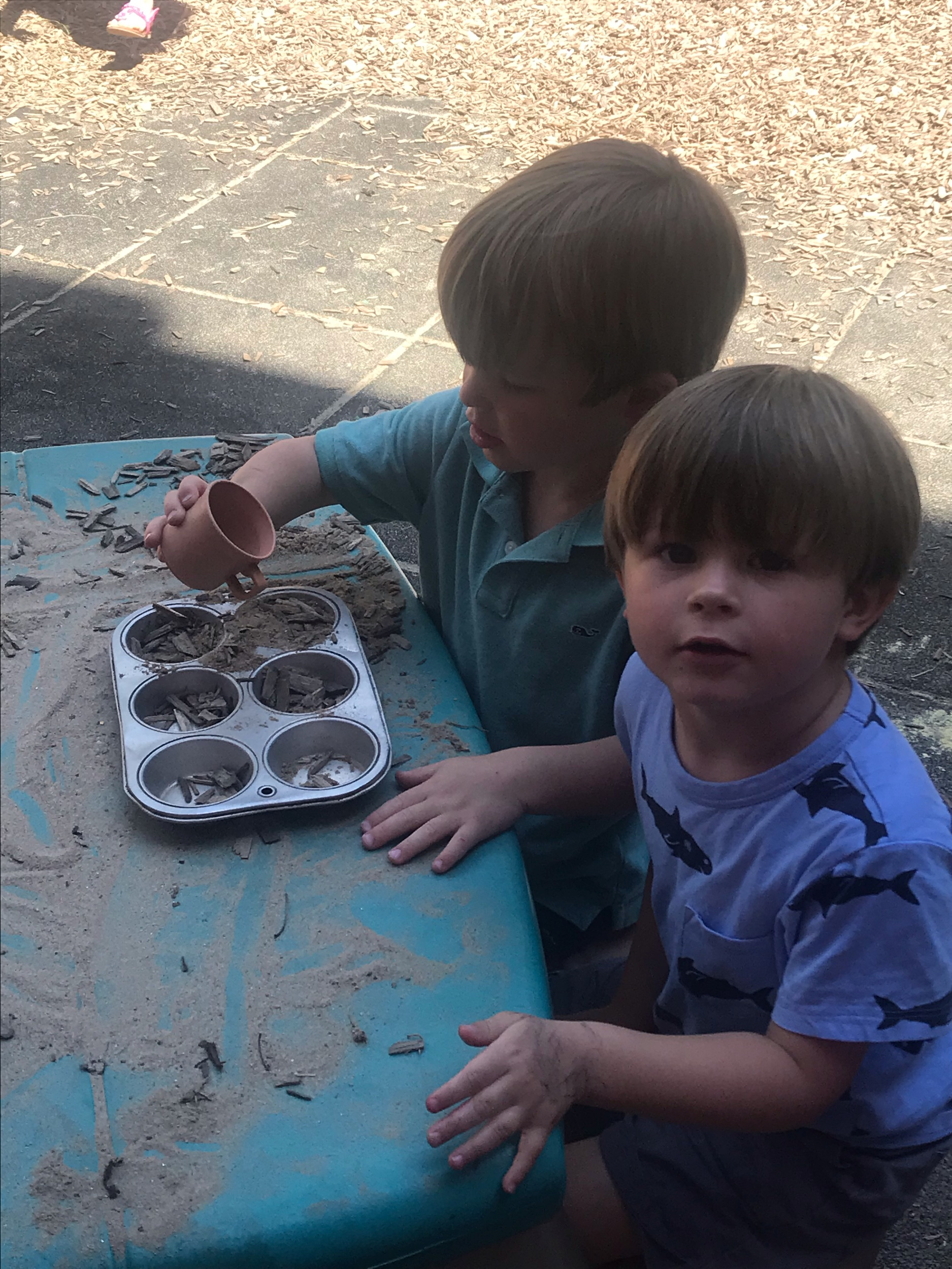 Charles and Coleman making cupcakes.