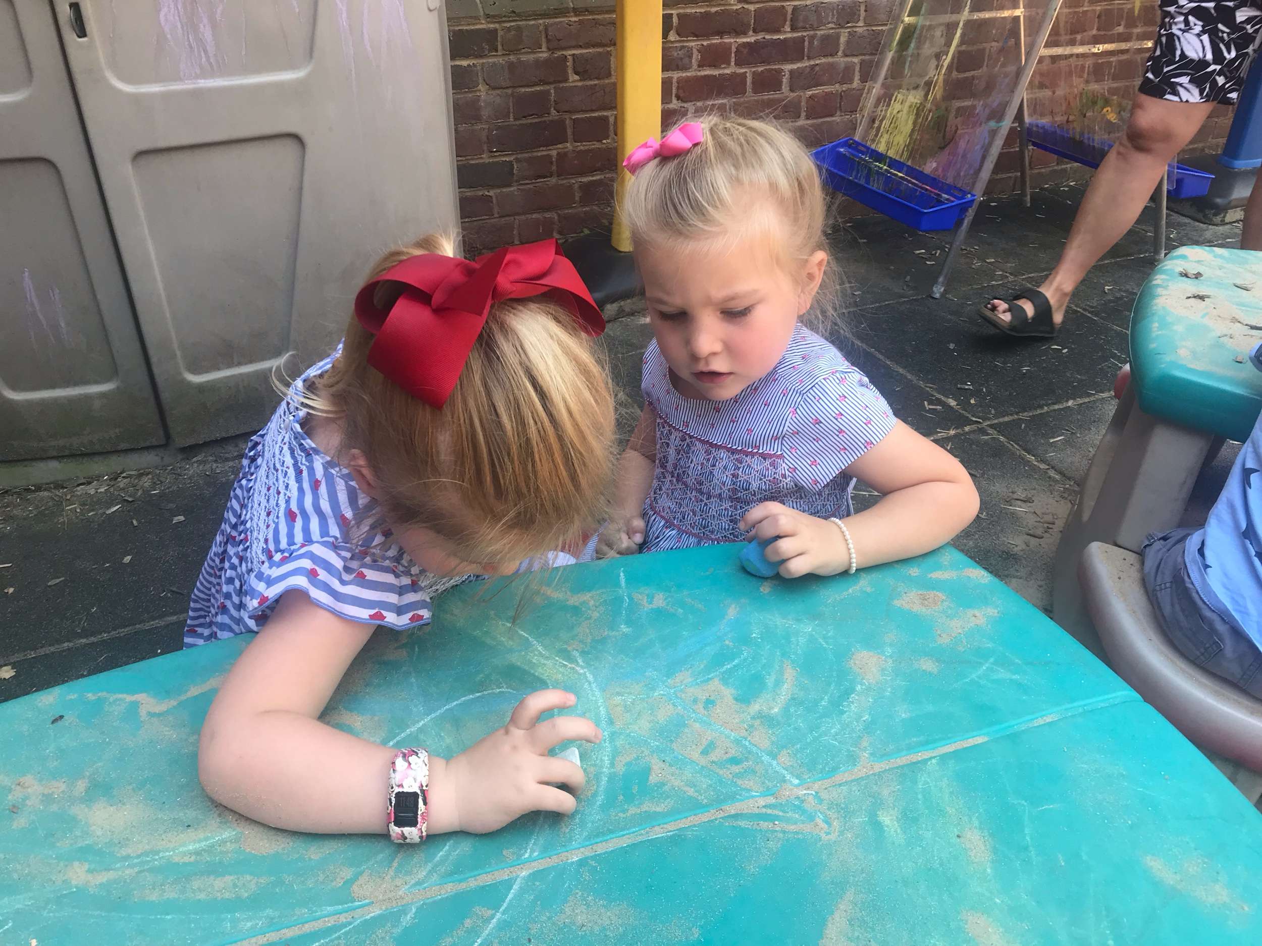 Scottie and Whitfield having fun with chalk in the courtyard.