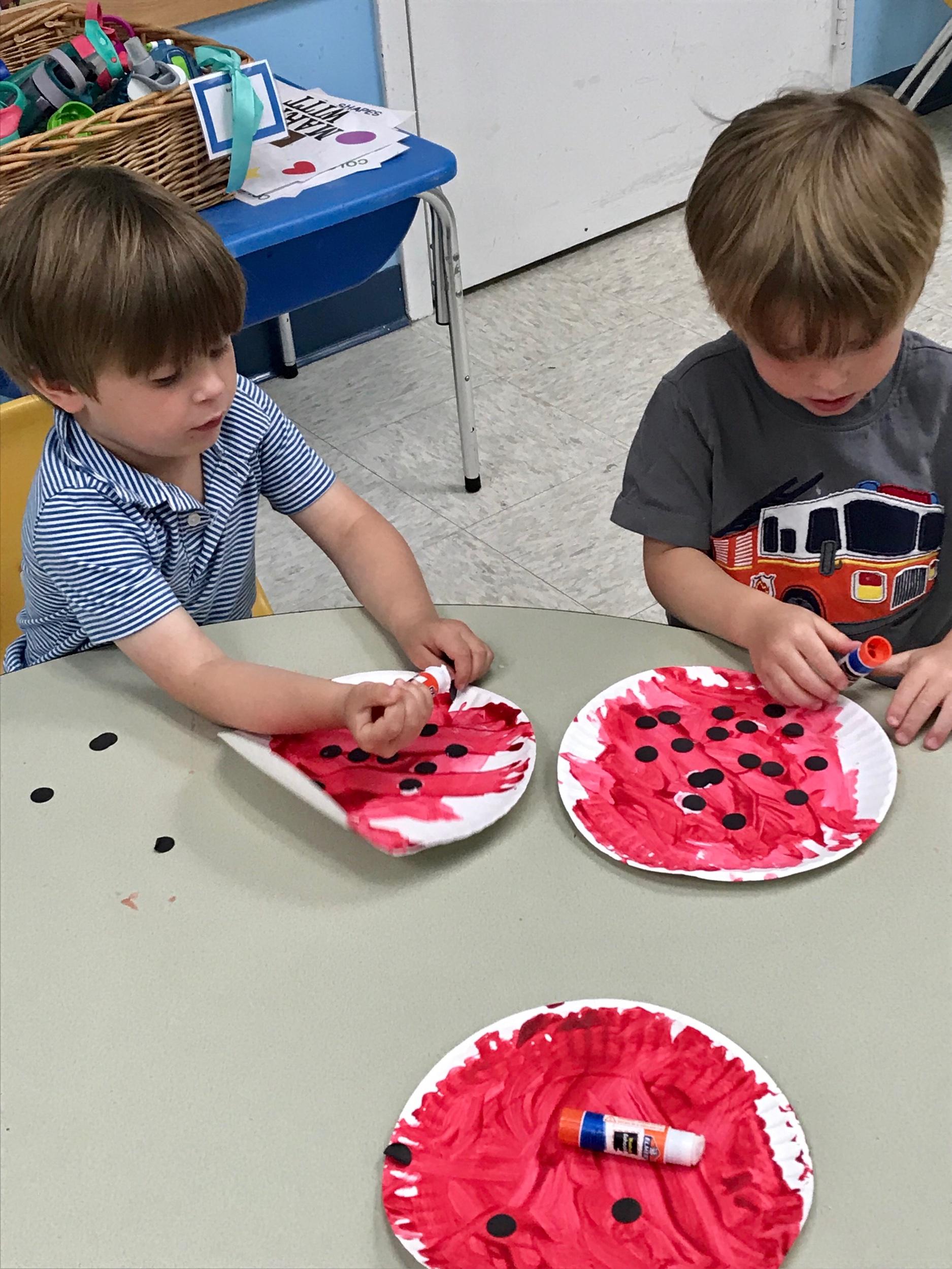 Finishing our ladybugs.