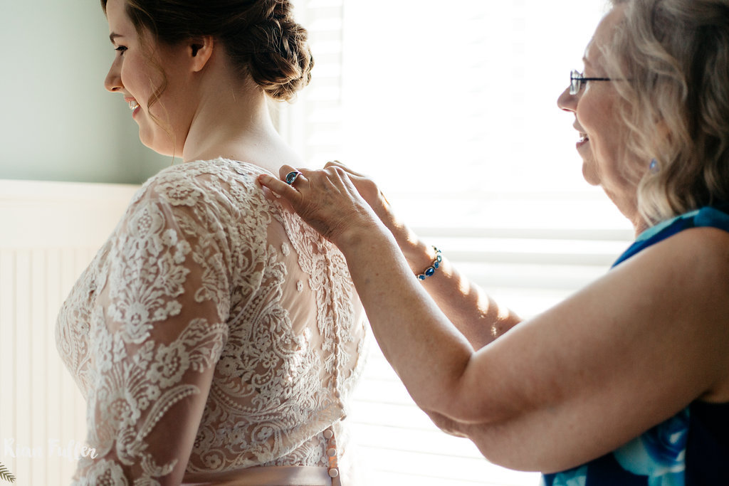 Bride Getting In Wedding Dress | Rian Fuller Photography
