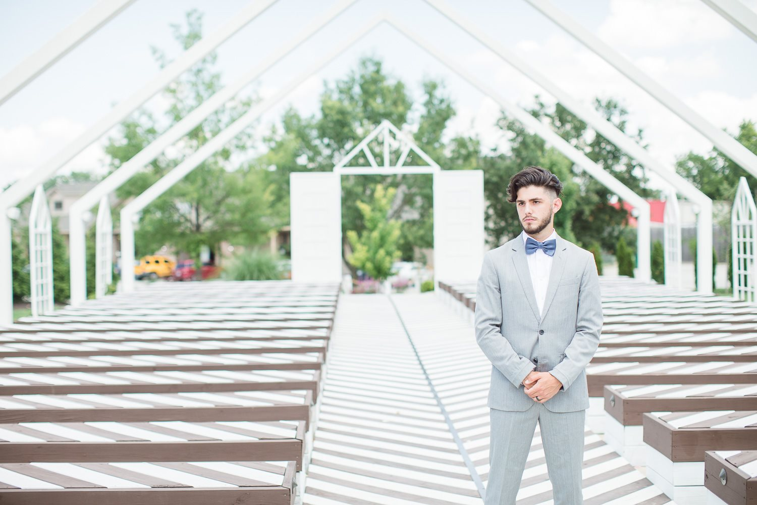 Groom waiting for first look with bride